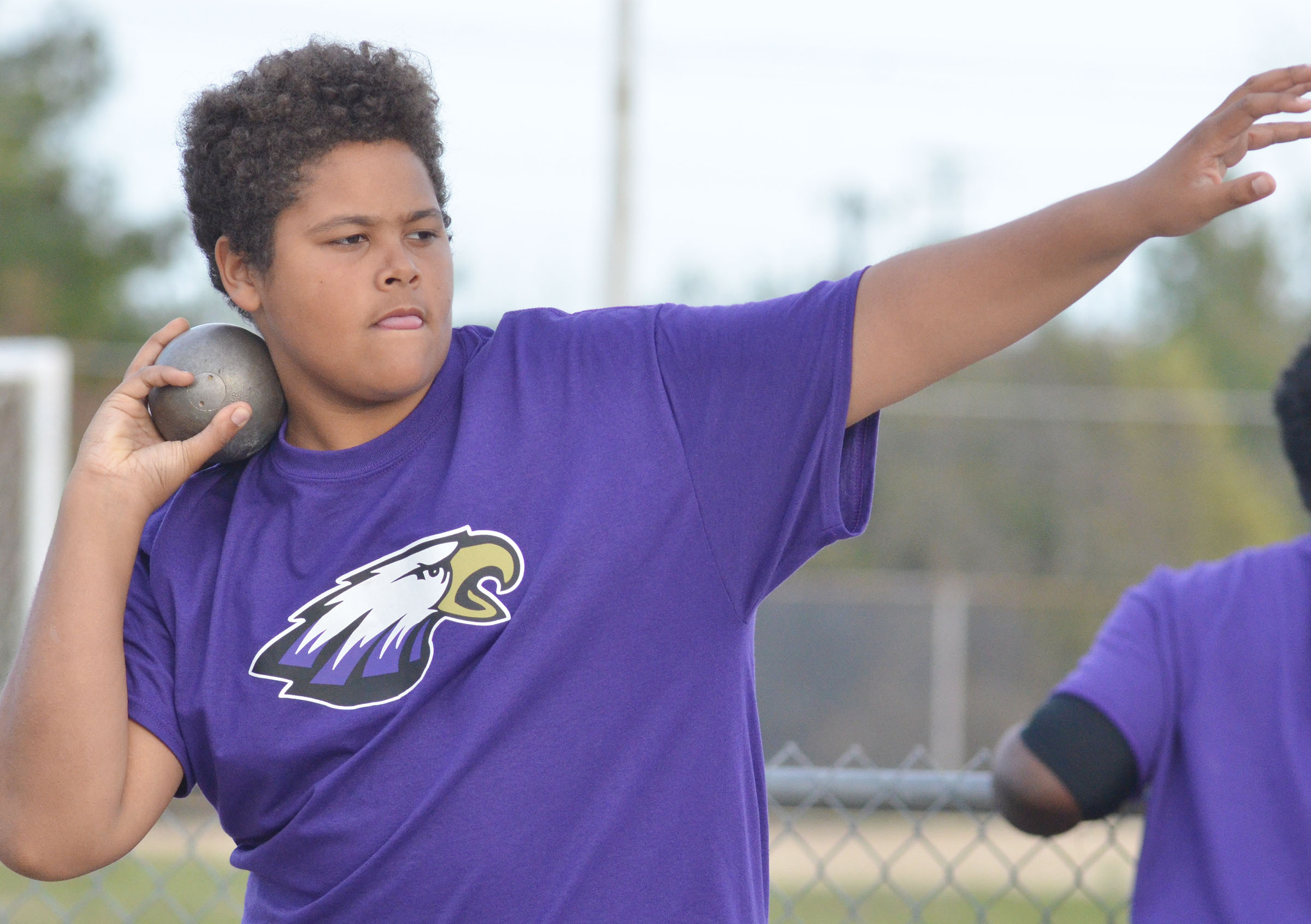 CMS seventh-grader Brandon Pittman throws shot put.