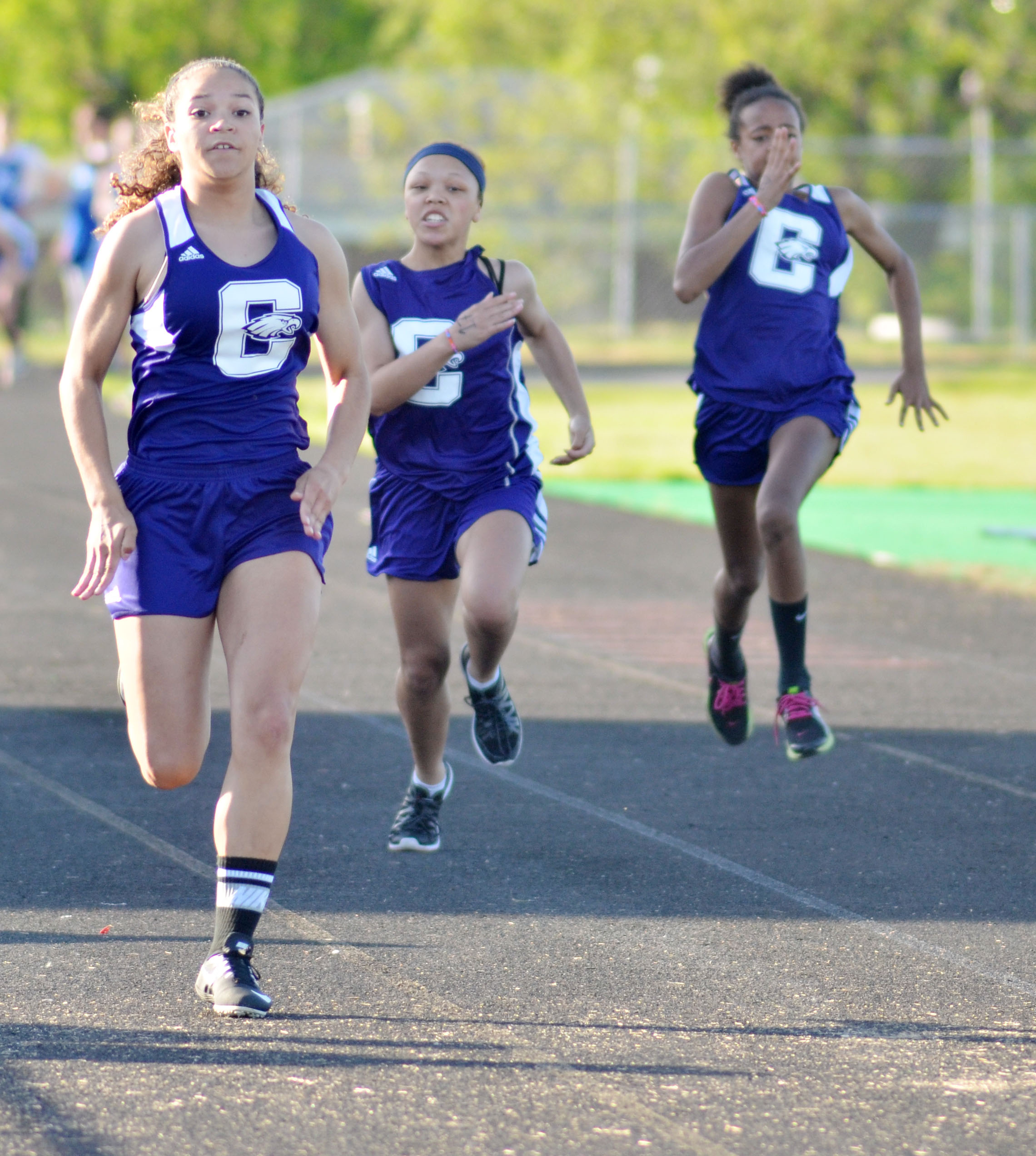 CHS freshman Taliyah Hazelwood wins the 100-meter dash. At right are Campbellsville Middle School seventh-graders Kitana Taylor and Aun Daya Coleman.