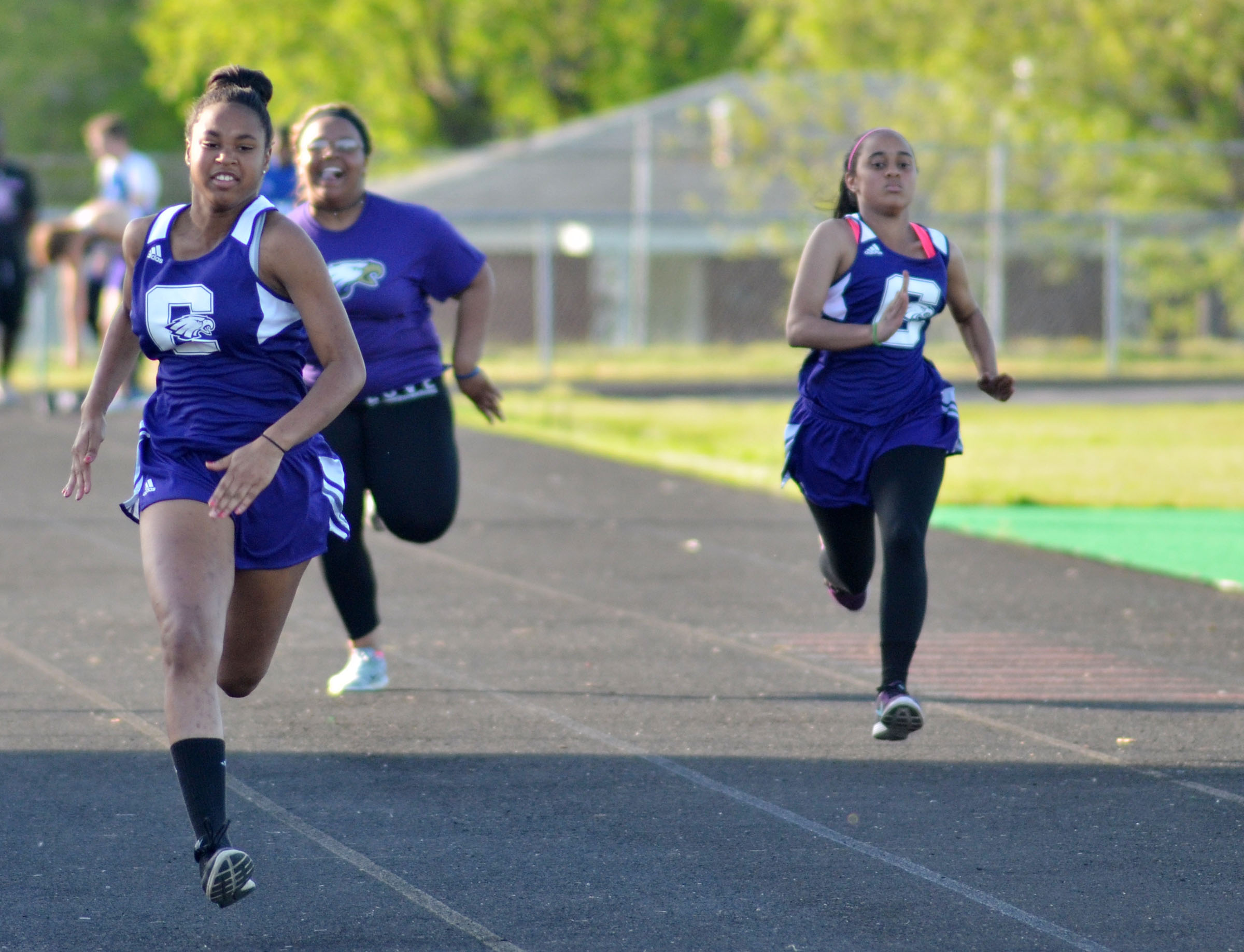 CHS freshman Isis Coleman gets out in front in the 100-meter dash. At right are sophomore Natalie Caldwell and freshman Jasmine Coro.