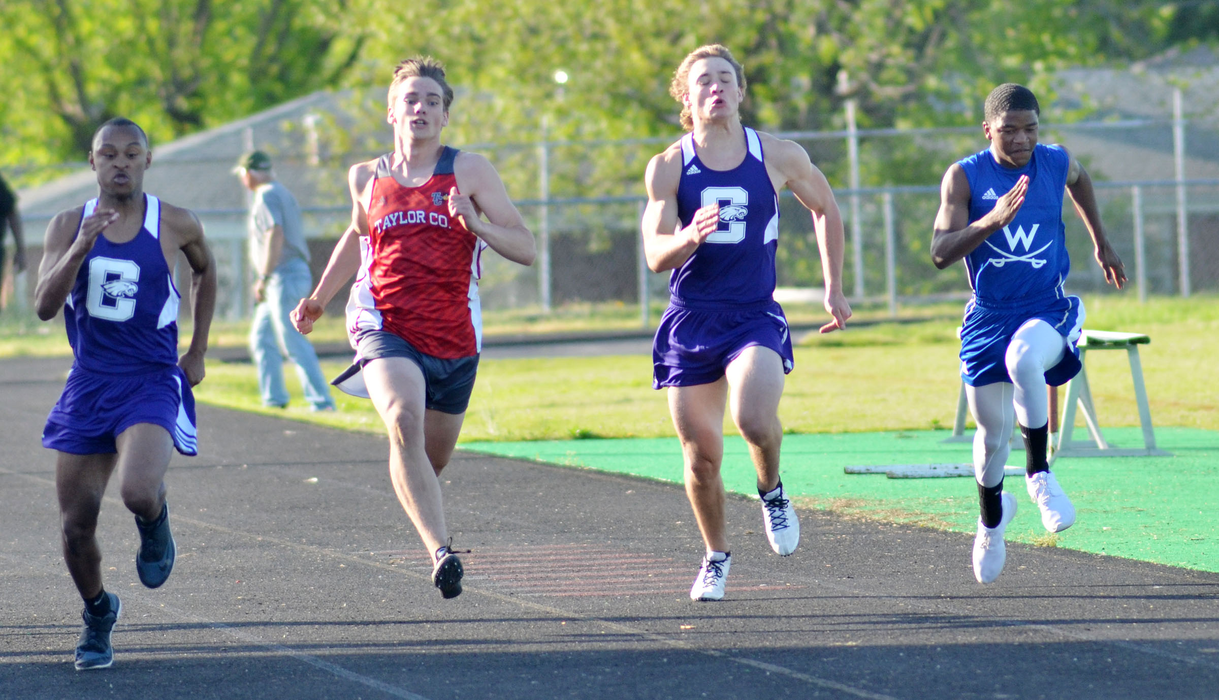CHS sophomore Daesean Vancleave, at left, and, third from left, classmate Tristan Johnson run the 100-meter dash.