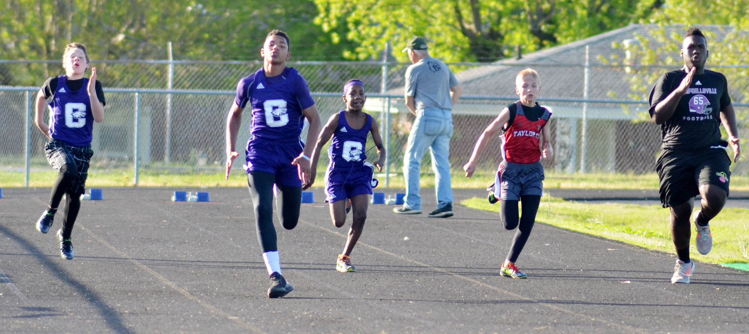 From left, Campbellsville Middle School seventh-grader Joshua Lucas, eighth-grader Reggie Thomas, seventh-grader Jadan Furman, and, at right, freshman Taekwon McCoy run.