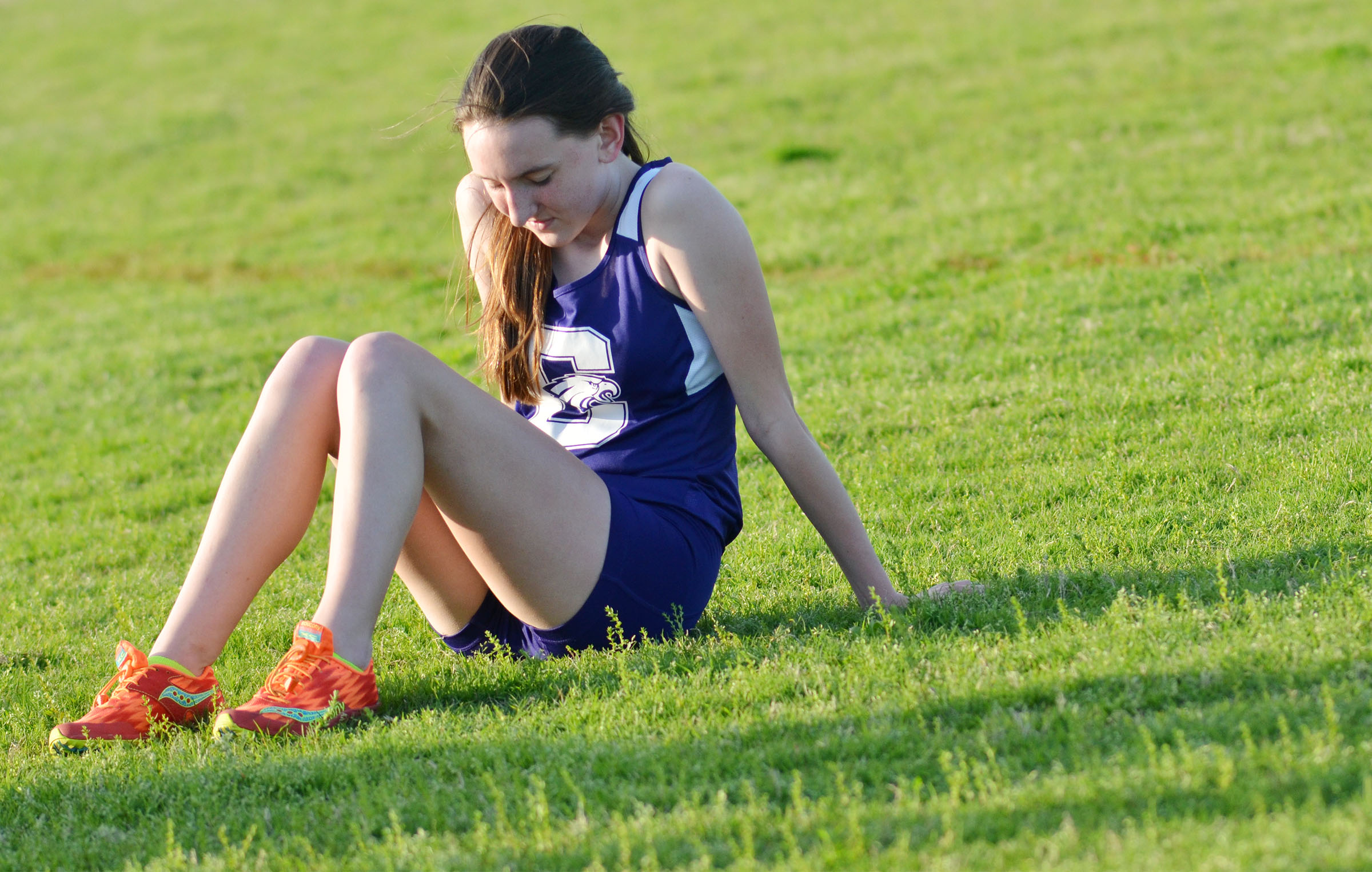CHS freshman Zoe McAninch rests after her run.
