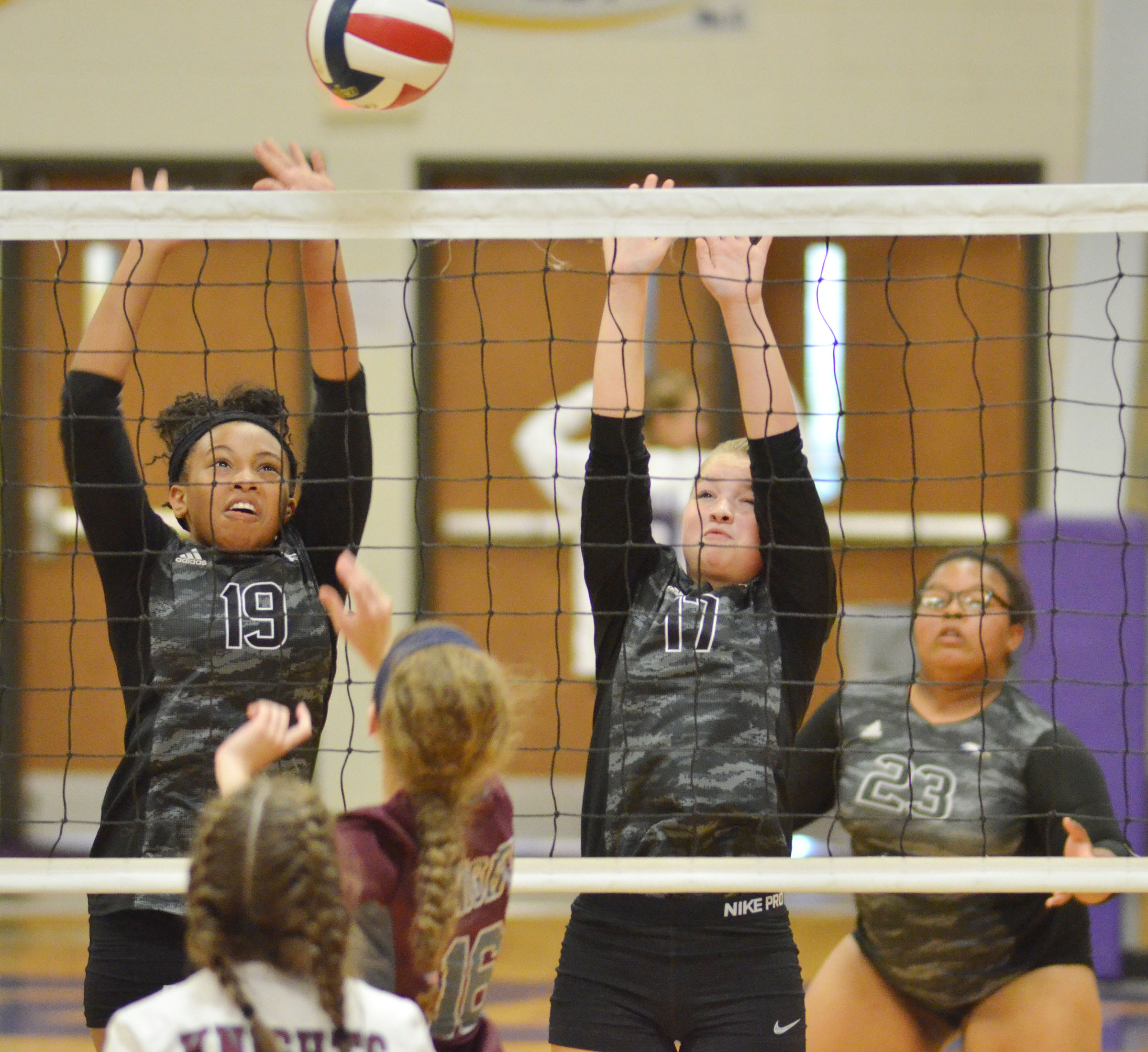 CHS freshmen Ketayah Taylor, at left, and Kaleigh Hunt jump to block the ball.