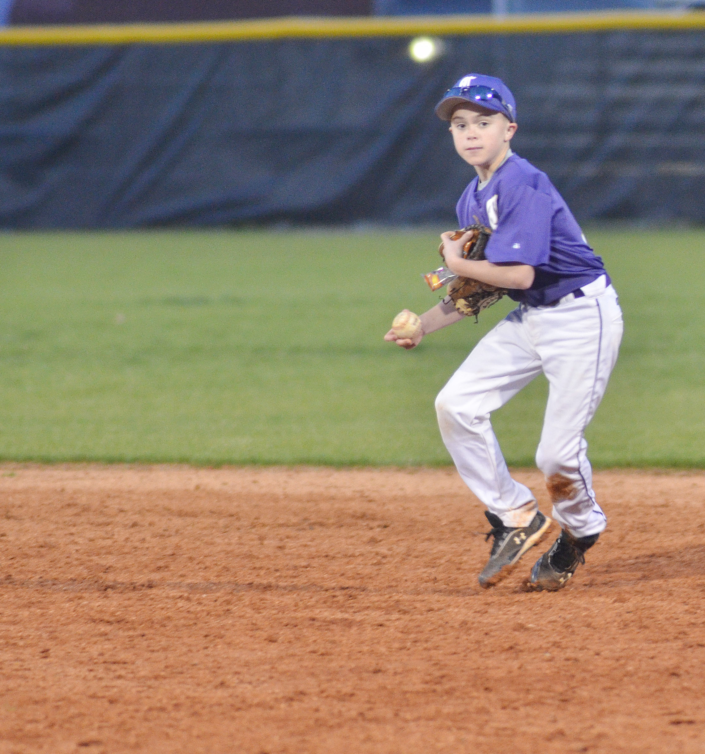 CMS sixth-grader Chase Hord throws to first.