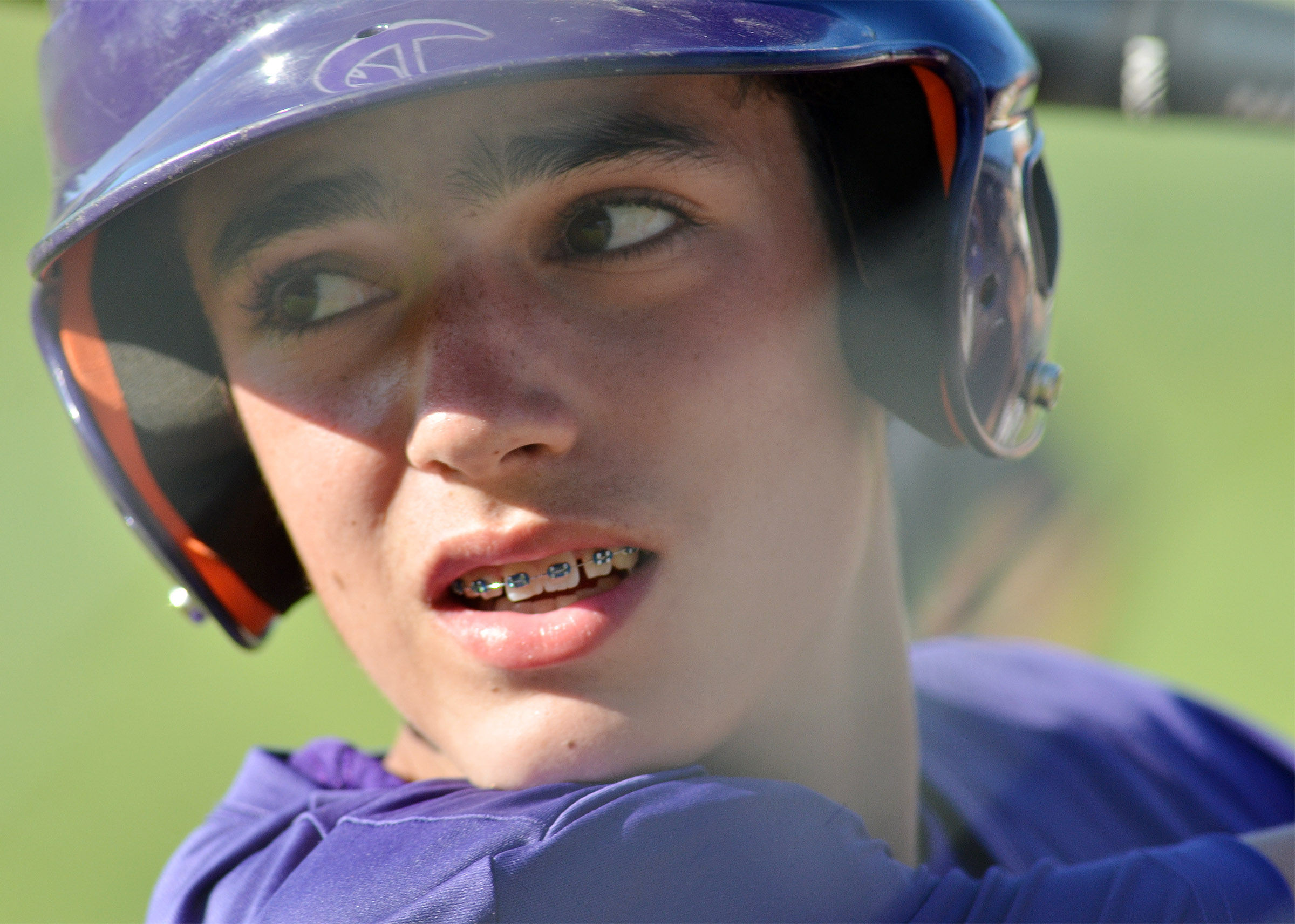CMS eighth-grader Kameron Smith watches as a teammate bats.