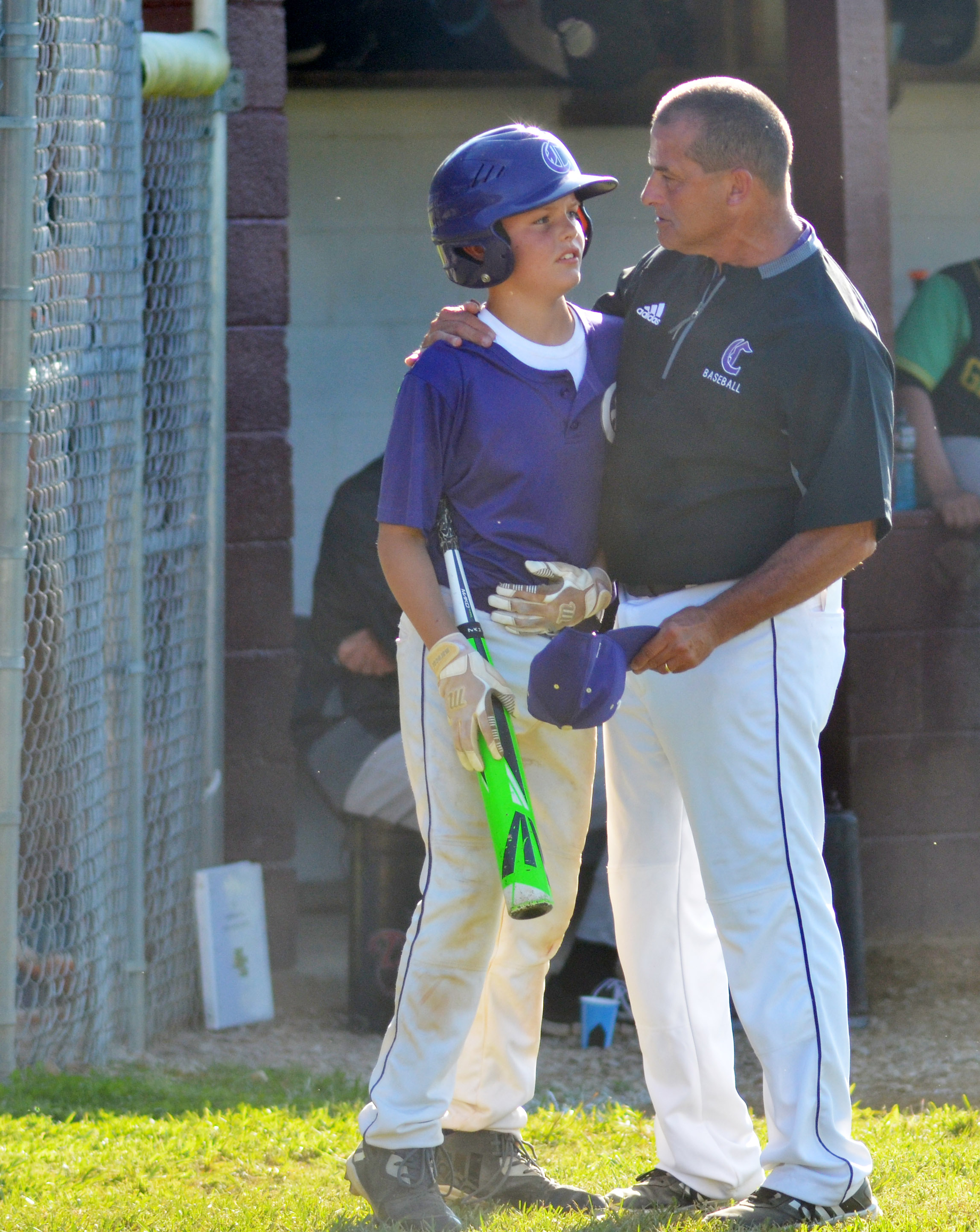 CMS head baseball coach Lynn Kearney talks to sixth-grader Konner Forbis as he gets set to bat.