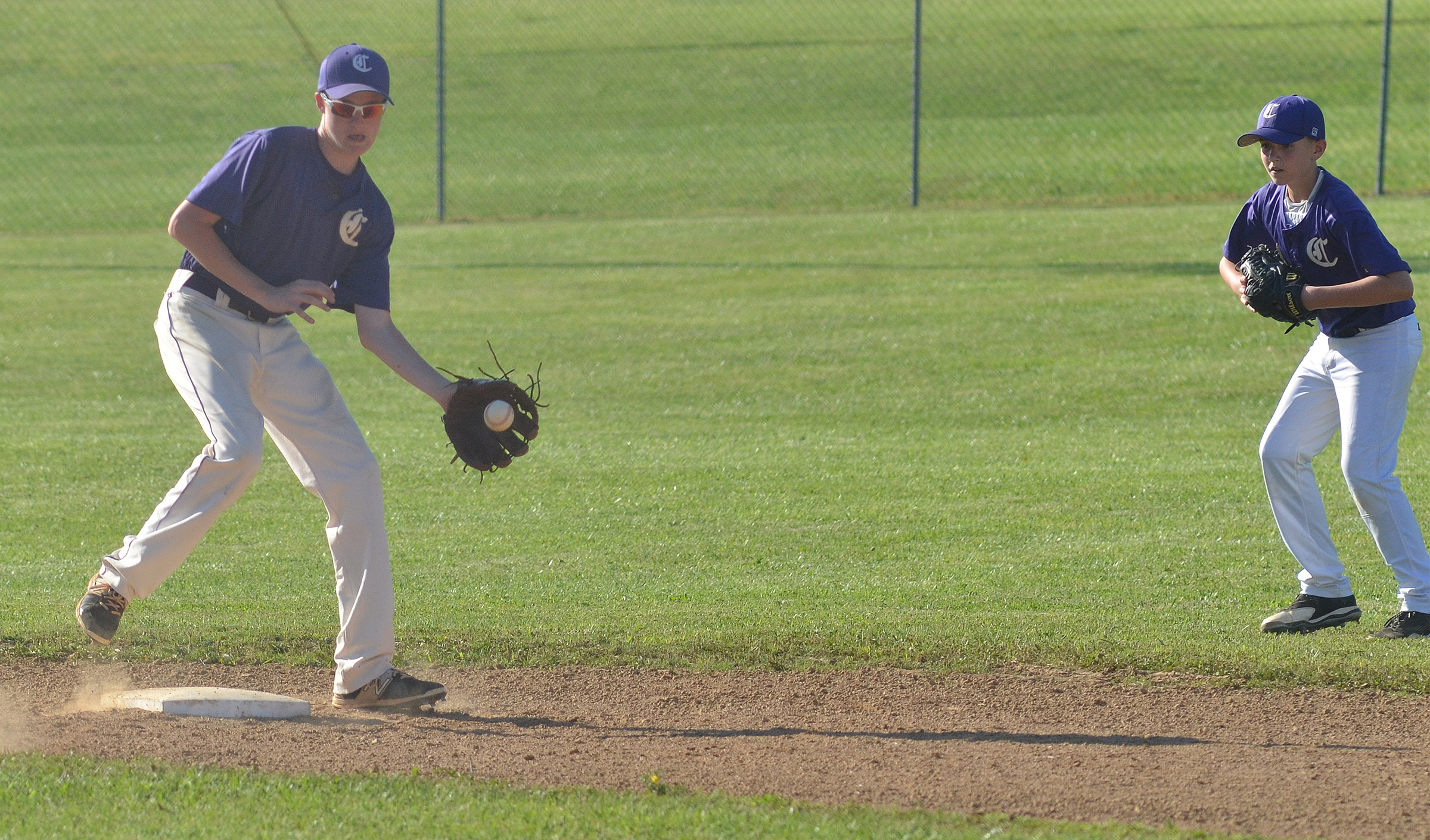 CMS eighth-grader Tristin Faulkner catches the ball at second.