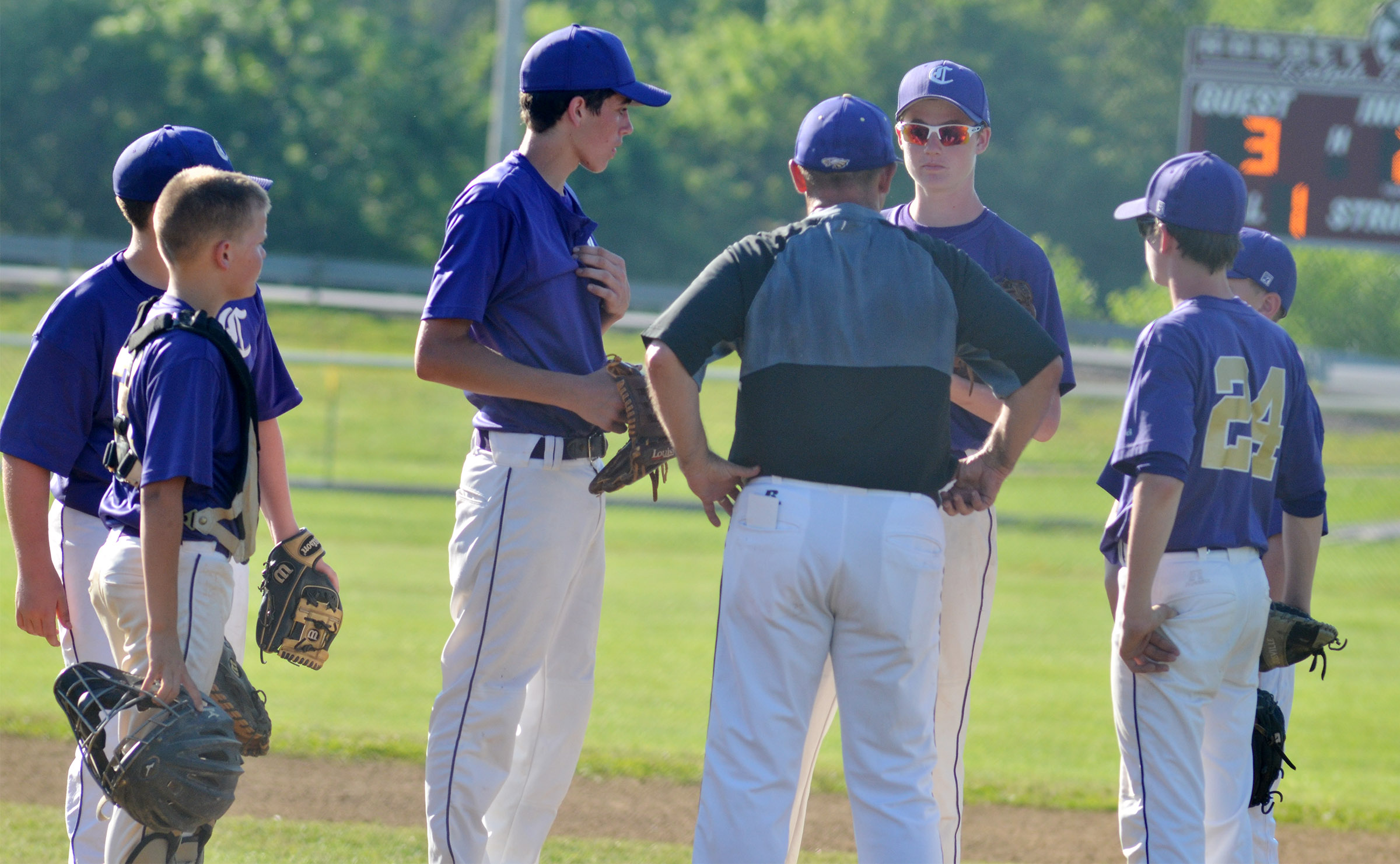 CMS head baseball coach Lynn Kearney talks to his players.