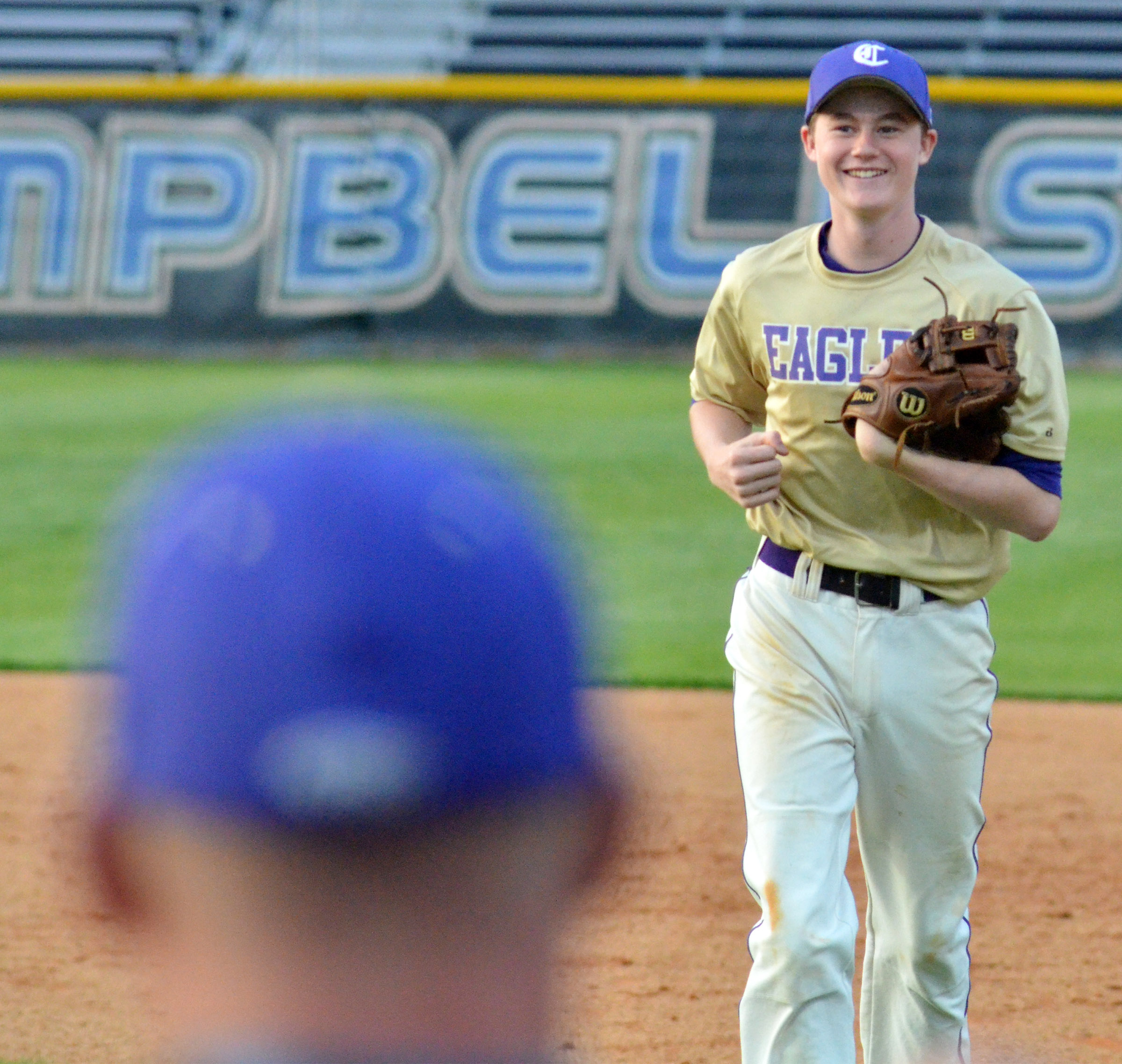 CMS eighth-grader Tristin Faulkner runs to the dugout after getting an out.