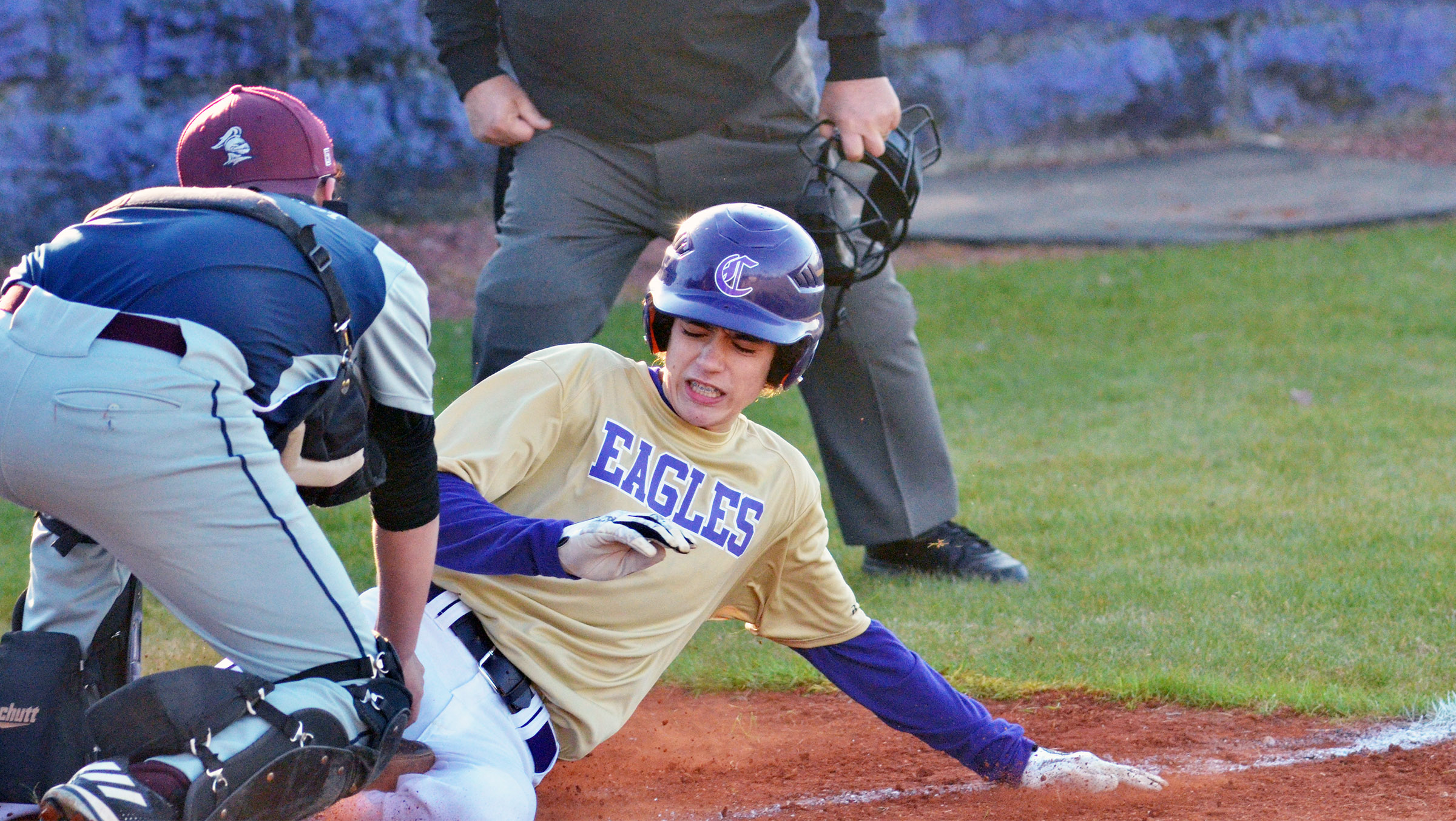 CMS eighth-grader Kameron Smith slides into home plate.