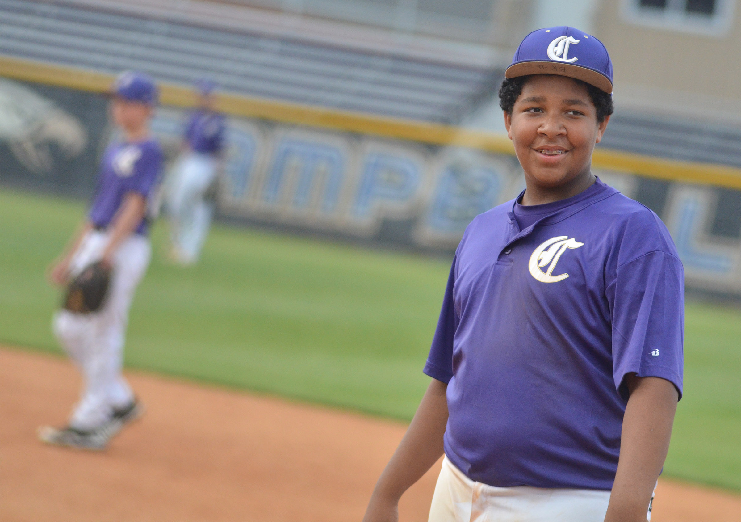 CMS seventh-grader Bryson Karr smiles as he mans first.