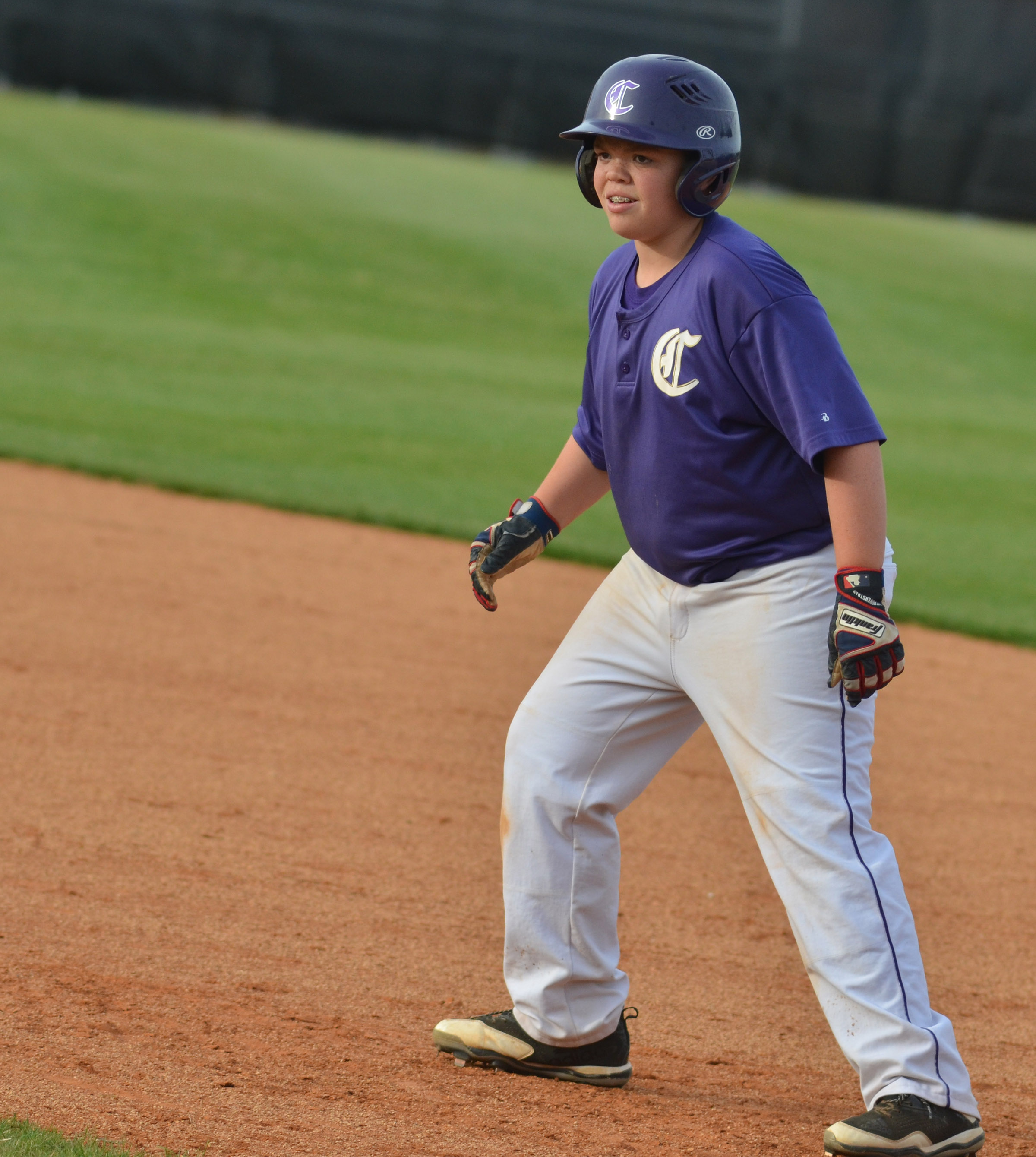 CMS sixth-grader Hayden Jones smiles as he nears second base.