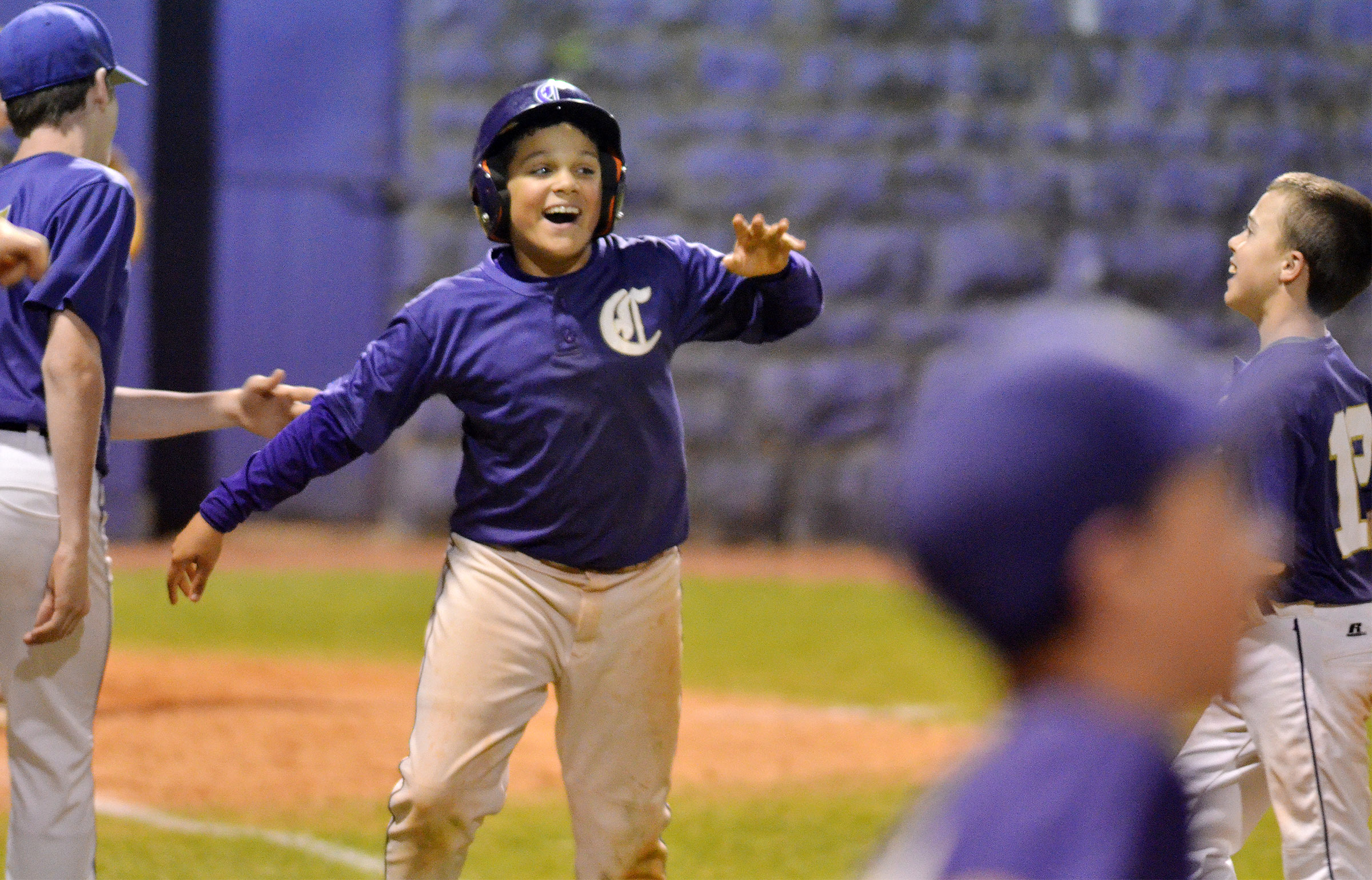 CMS sixth-grader Kaydon Taylor celebrates as his team wins.