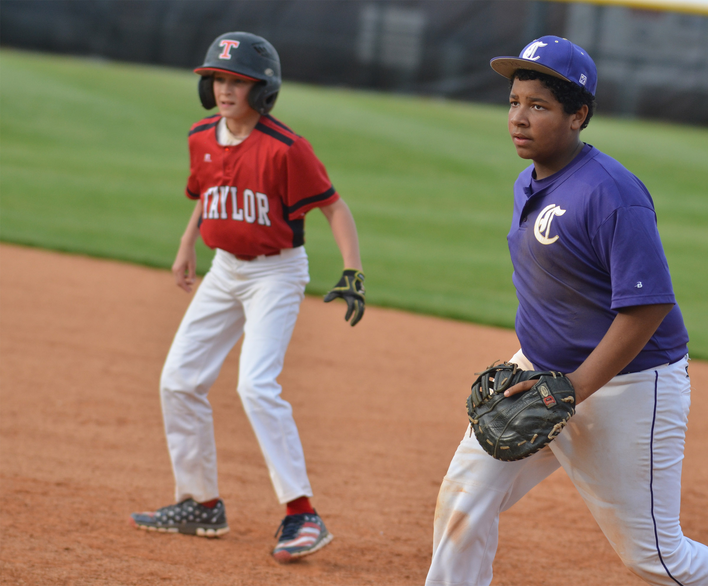 CMS seventh-grader Bryson Karr keeps the runner close to first base.