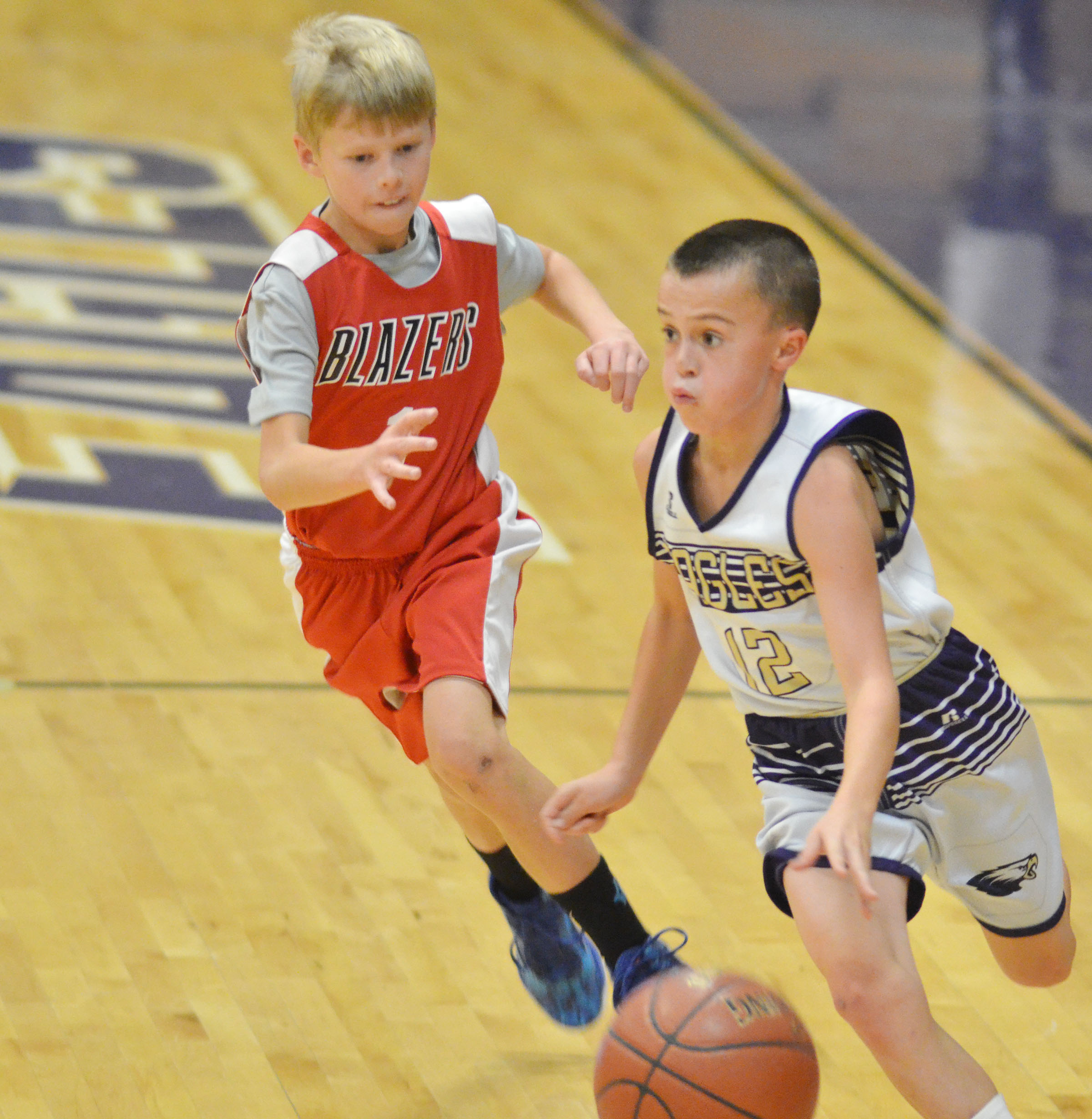 CMS sixth-grader Chase Hord dribbles to the basket.