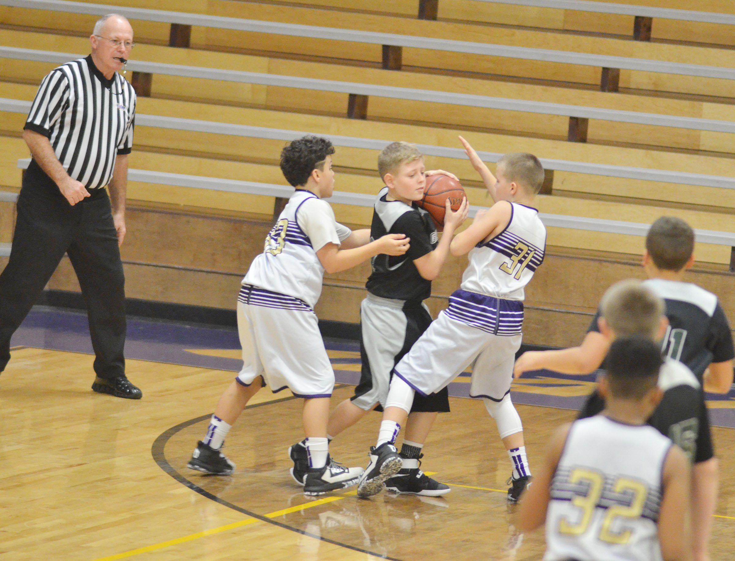 CMS sixth-graders Kaydon Taylor, at left, and Konner Forbis battle for the ball.