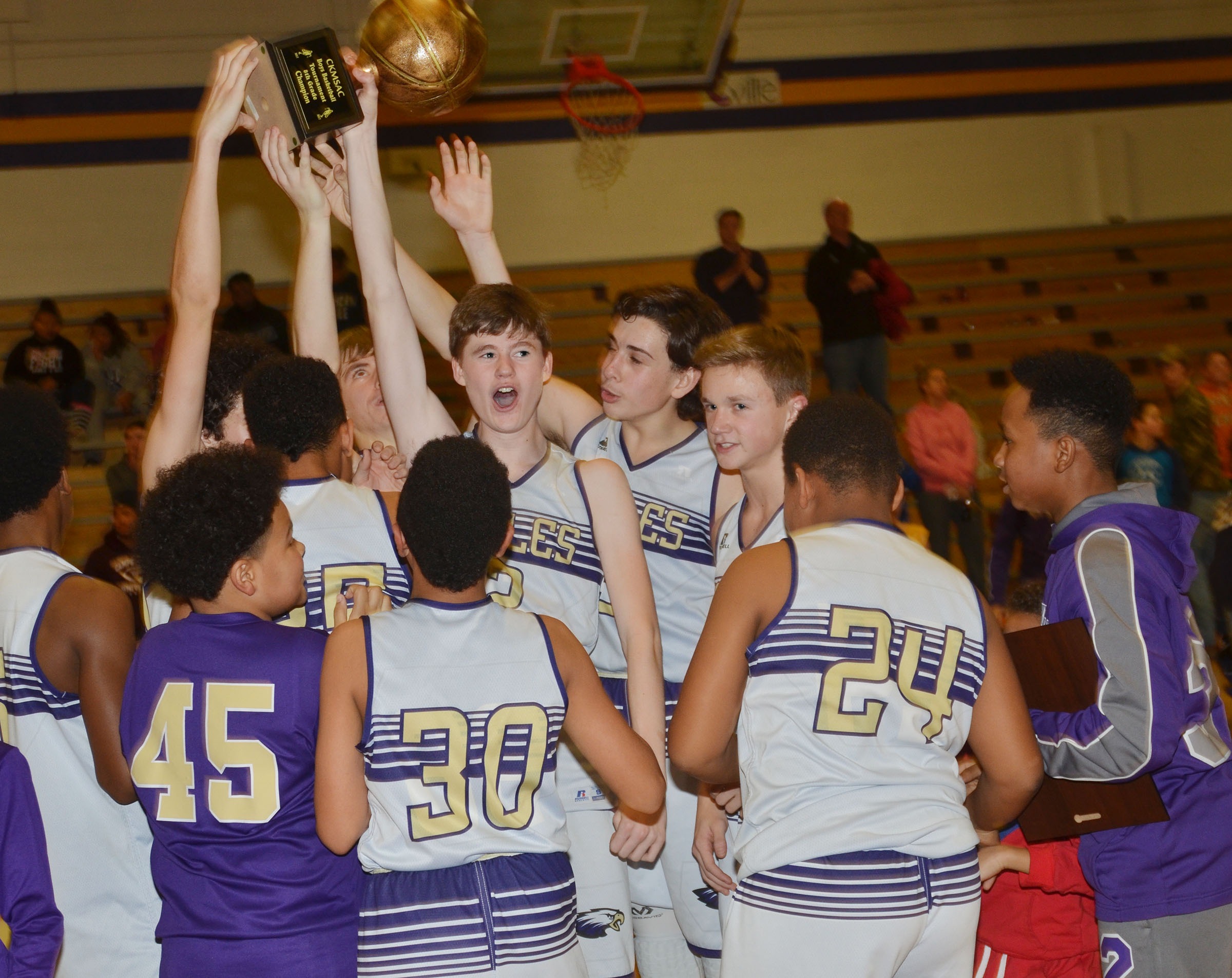 CMS eighth-grader Tristin Faulkner and his teammates hold the CKMSAC tournament championship trophy high.