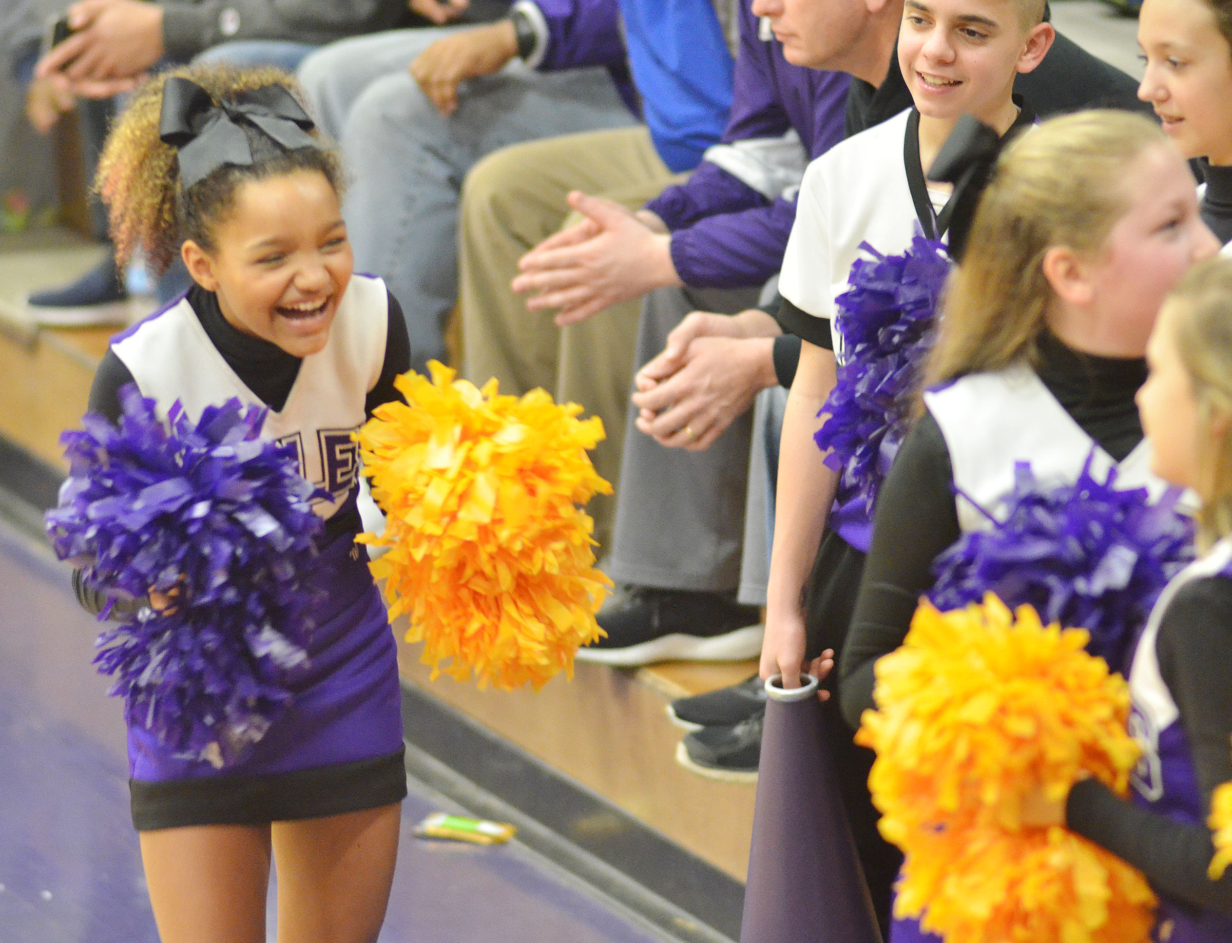 CMS seventh-grader Alexis Thomas laughs with her fellow cheerleaders.