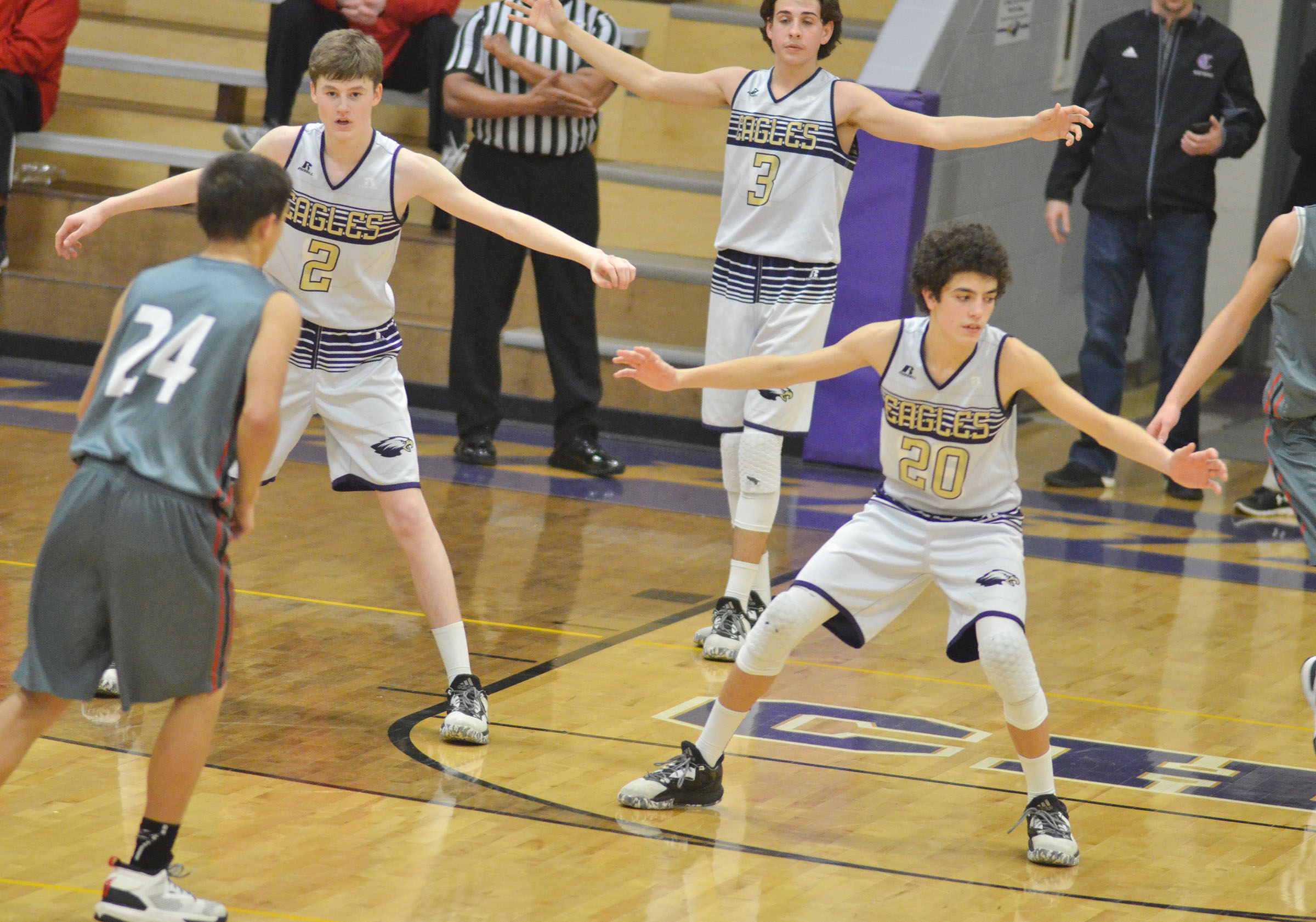 From left, CMS eighth-graders Tristin Faulkner, John Orberson and Kameron Smith get set to play defense.