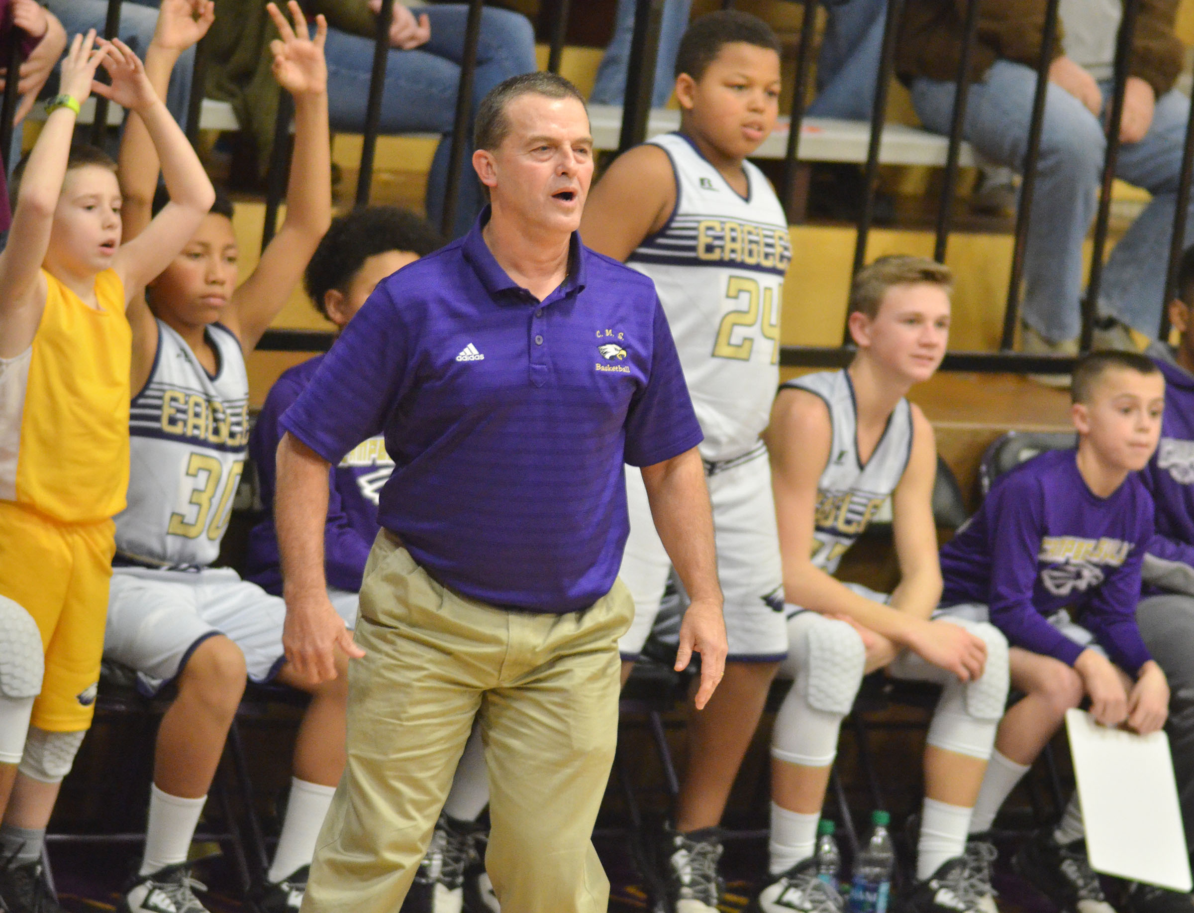 CMS boys' basketball coach Lynn Kearney watches as his players take the lead.