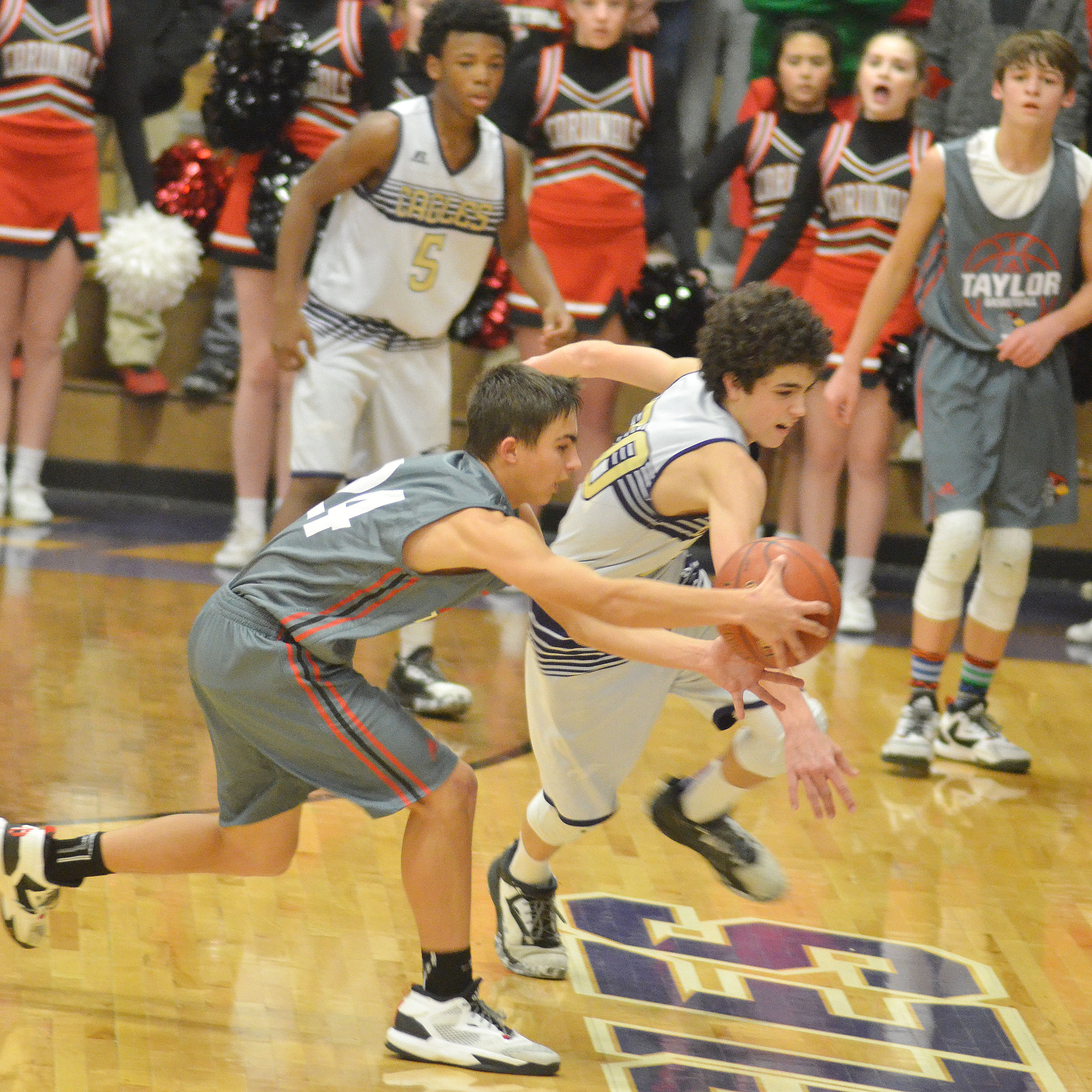CMS eighth-grader Kameron Smith fights for the ball.