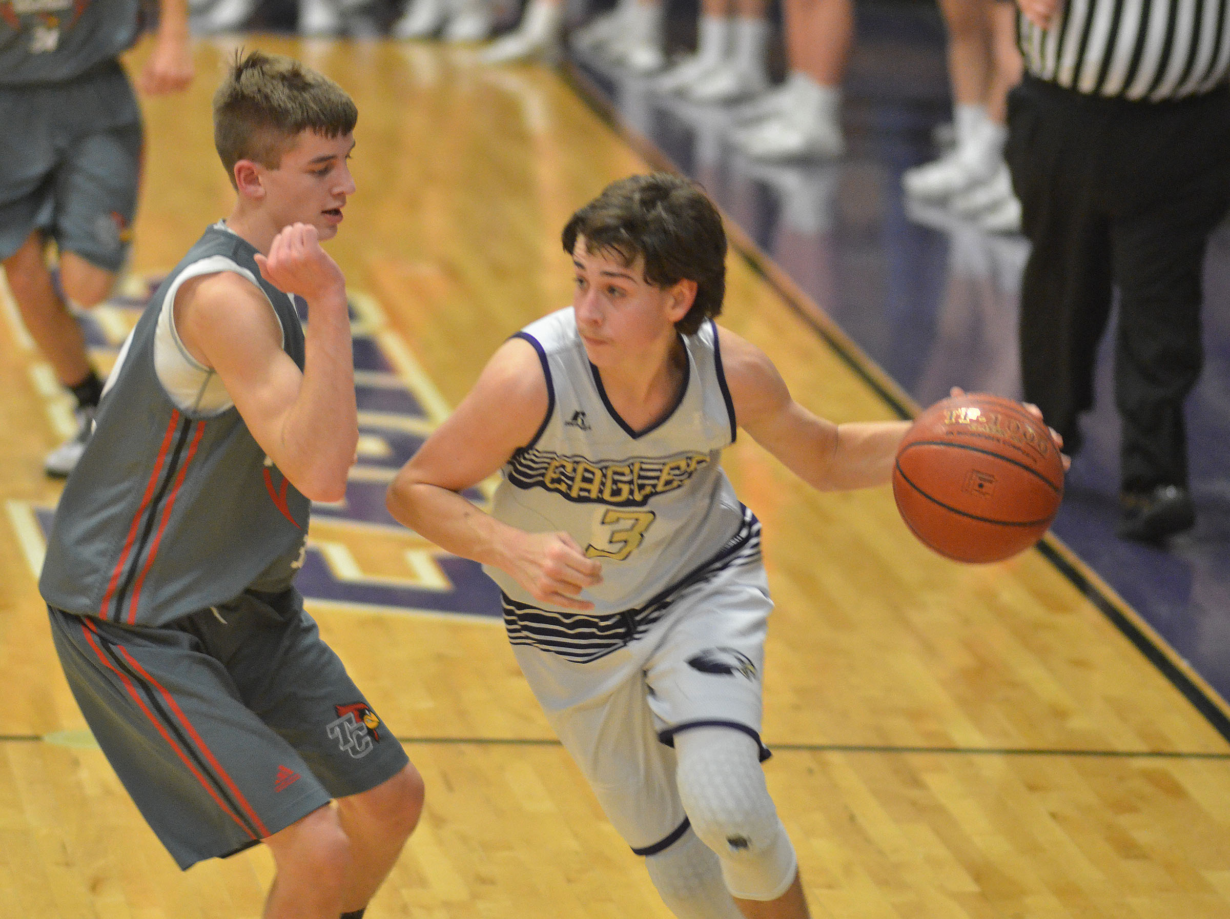 CMS eighth-grader John Orberson dribbles around a Taylor County defender.