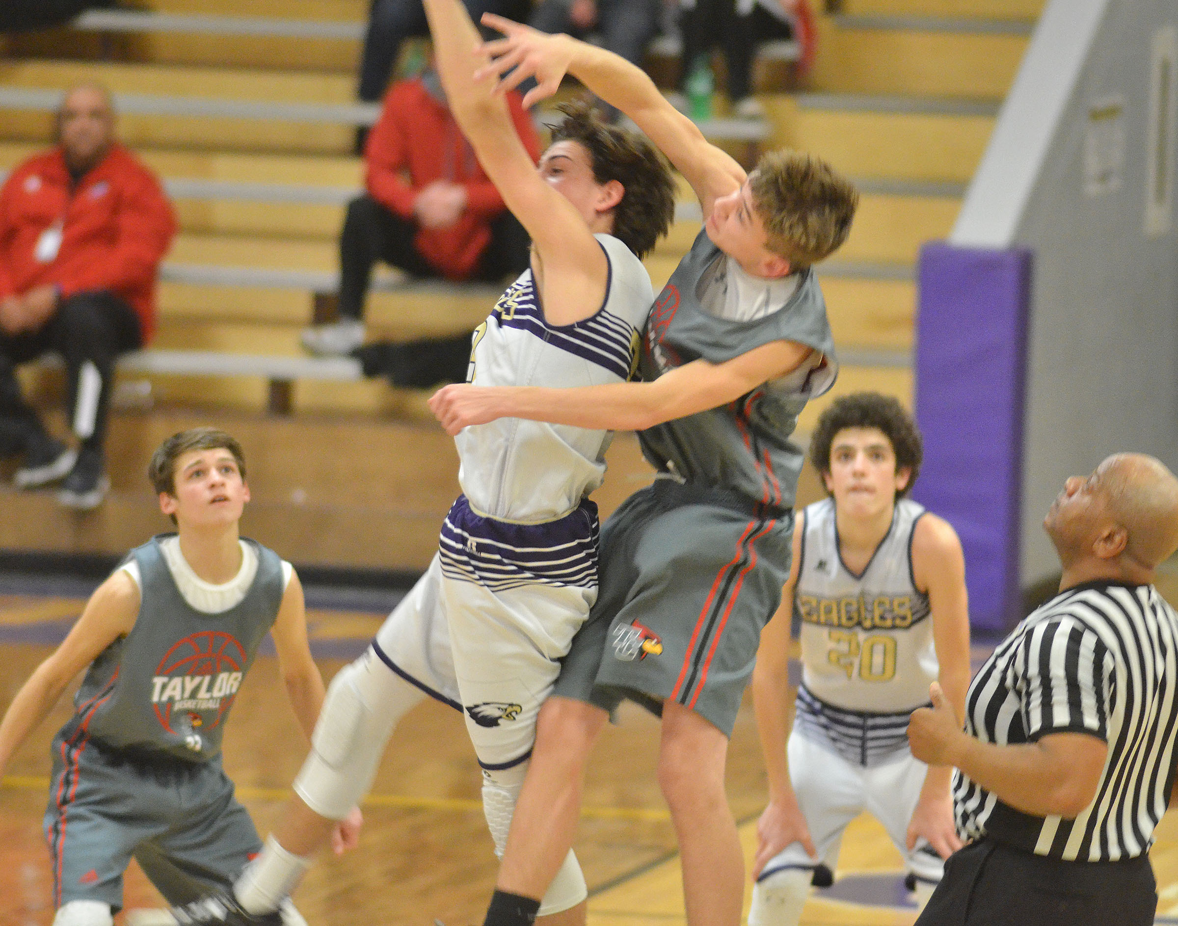 CMS eighth-grader John Orberson jumps for the ball as the overtime period begins.
