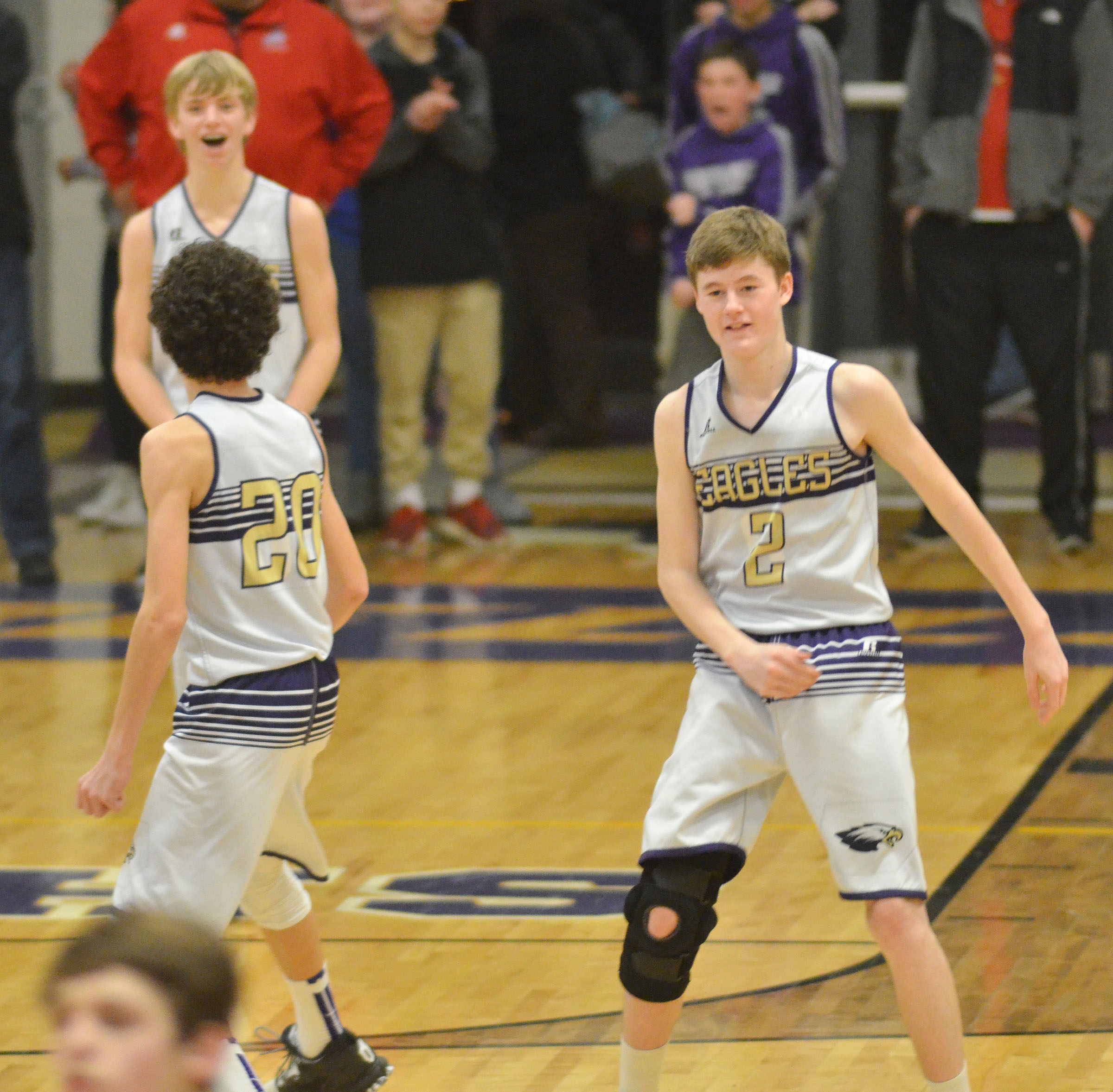 CMs eighth-graders Kameron Smith, at left, and Tristin Faulkner begin to celebrate their win with teammate Arren Hash, in back.