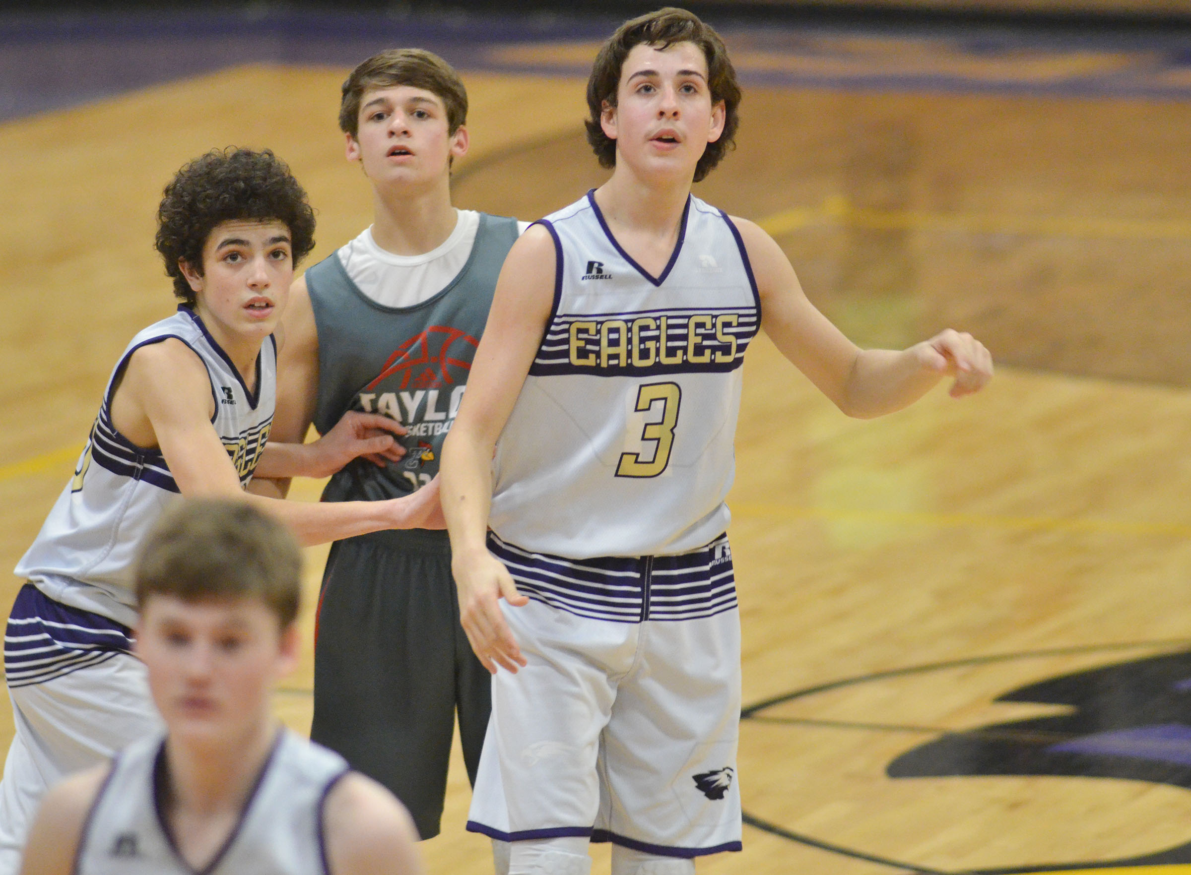 CMS eighth-graders Kameron Smith, at left, and John Orberson watch as the overtime period expires.