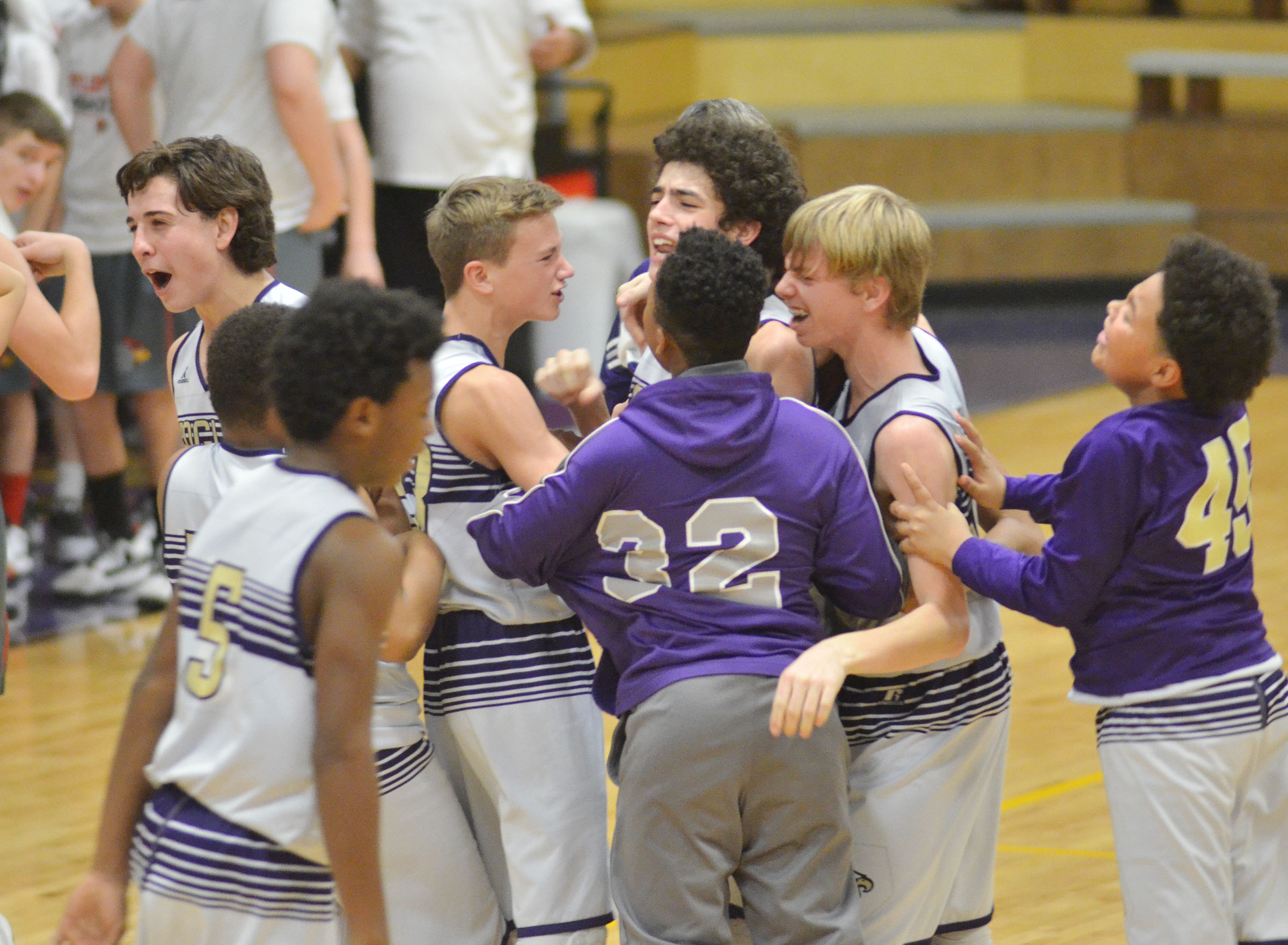 CMS eighth-graders celebrate their win.