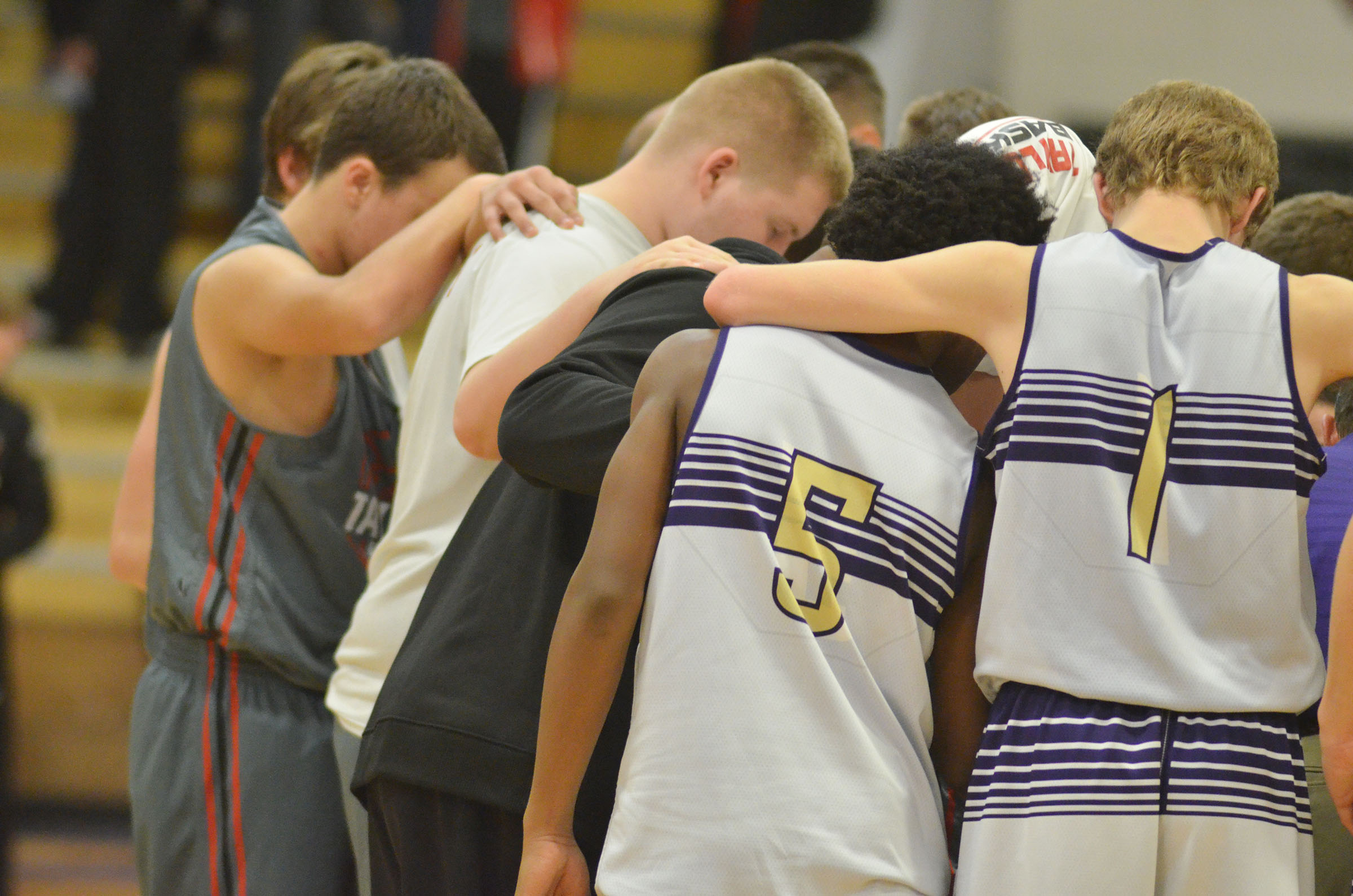 After the game, CMS and TCMS players gather to pray together.