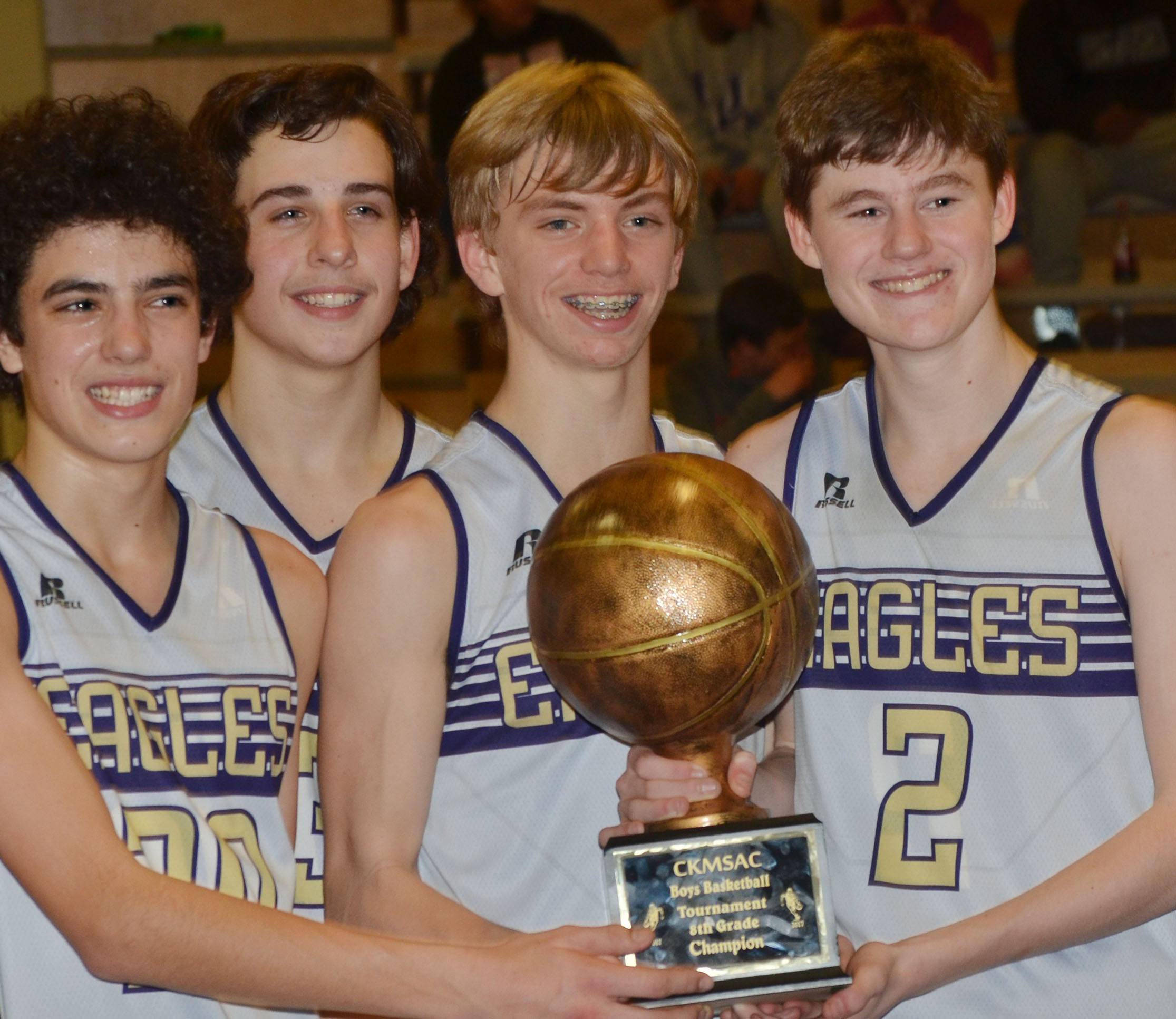 CMS eighth-graders, from left, Kameron Smith, John Orberson, Arren Hash and Tristin Faulkner hold their championship trophy.