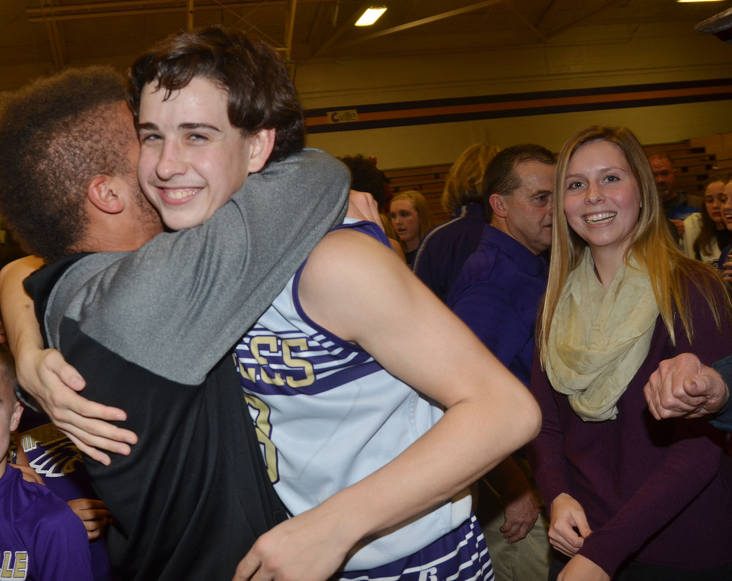 CMS eighth-grader John Orberson hugs Campbellsville High School junior Ethan Lay after the game. At right is Orberson's sister, Becca.