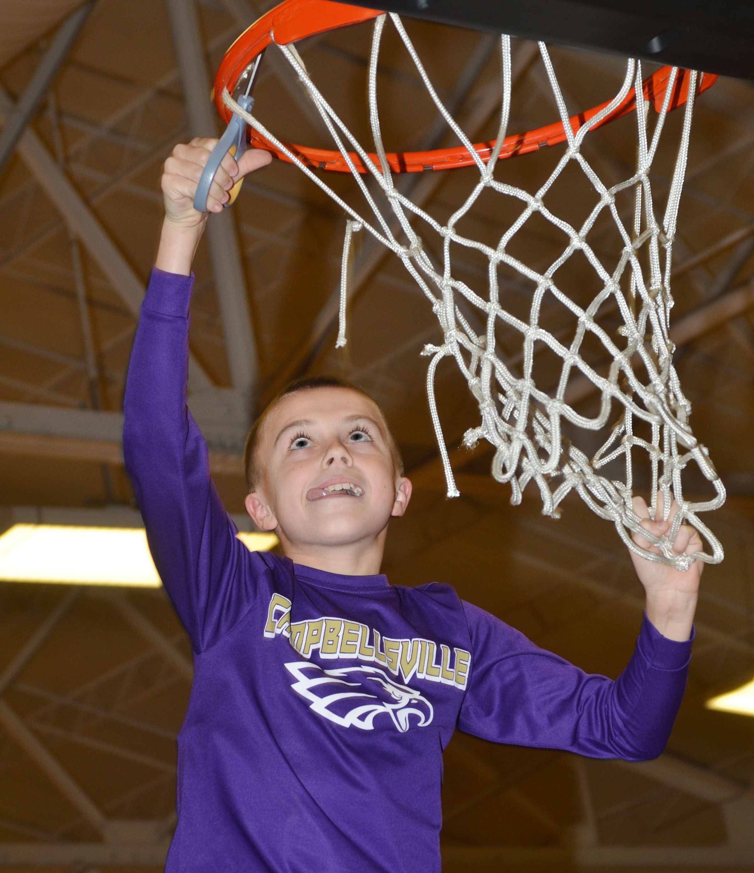 CMS sixth-grader Chase Hord cuts down part of the net.