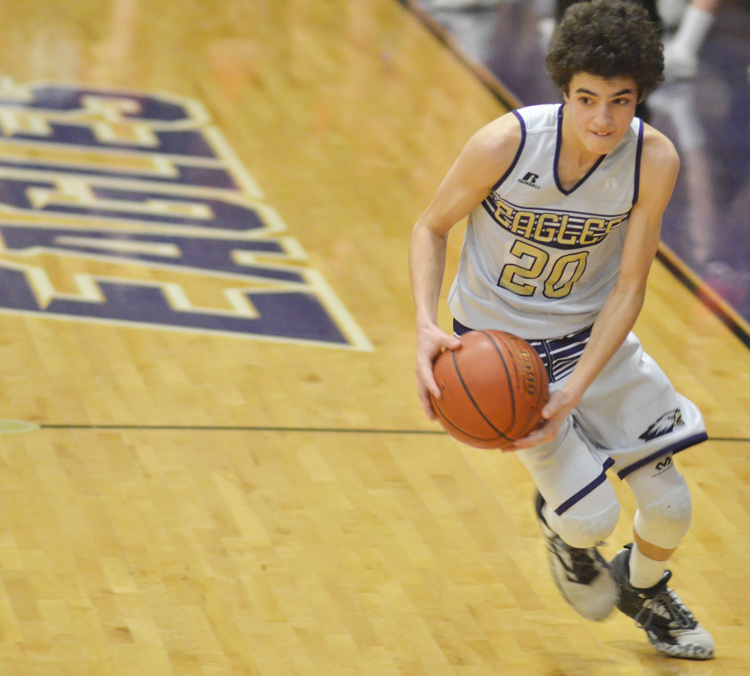 CMS eighth-grader Kameron Smith runs to the basket.