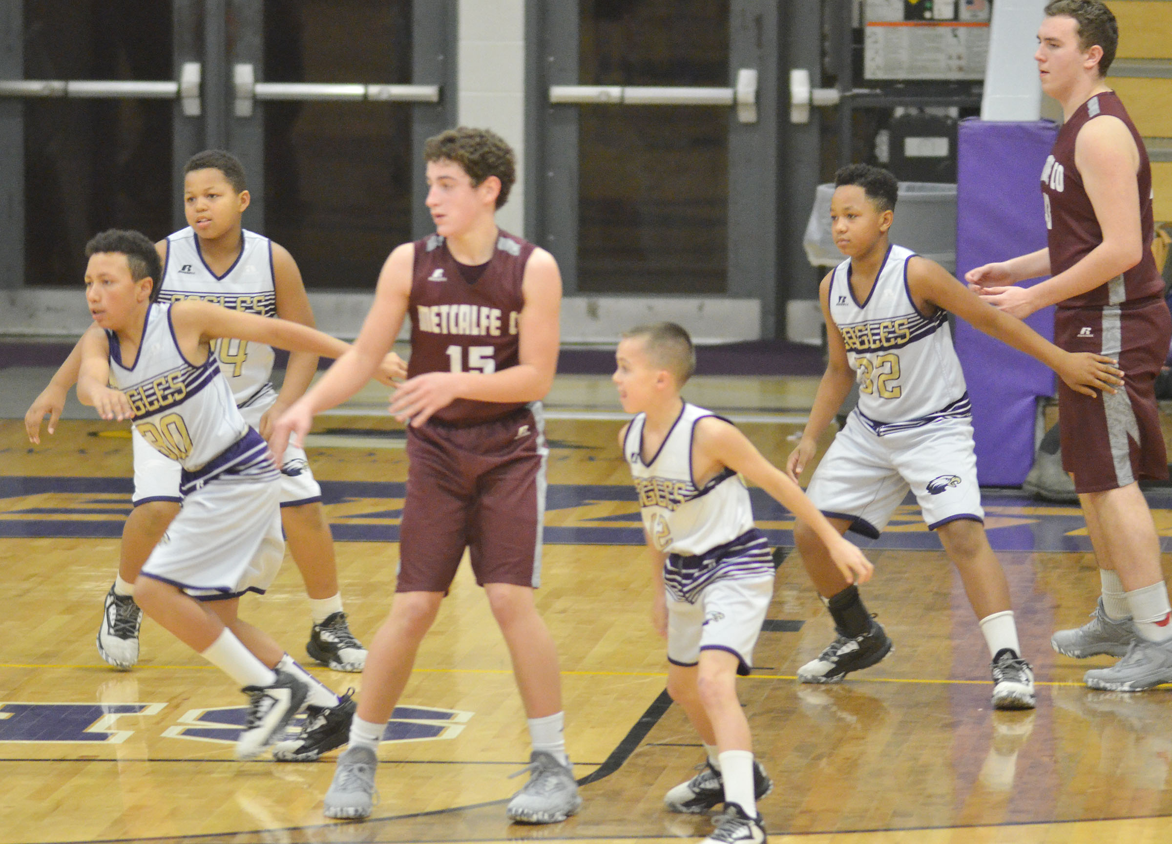 From left, CMS eighth-grader Jastyn Shively and sixth-graders Keondre Weathers, Chase Hord and Deondre Weathers play defense.