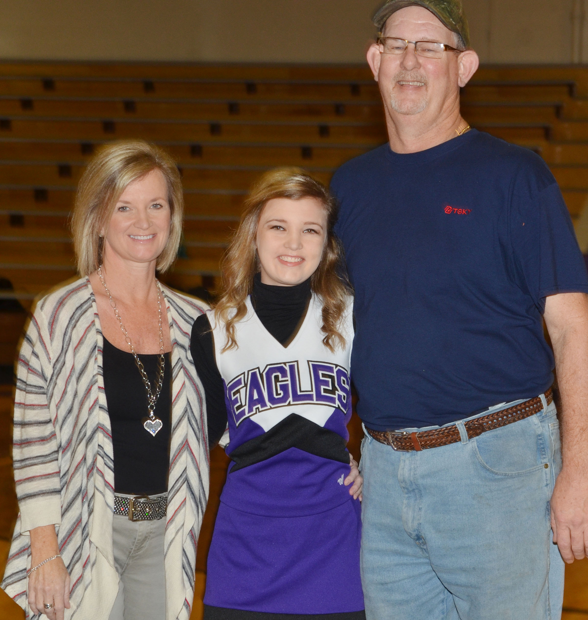 CMS eighth-grader Carly Adams is honored. She is pictured with her parents, Melanie Cox and Todd Adams.