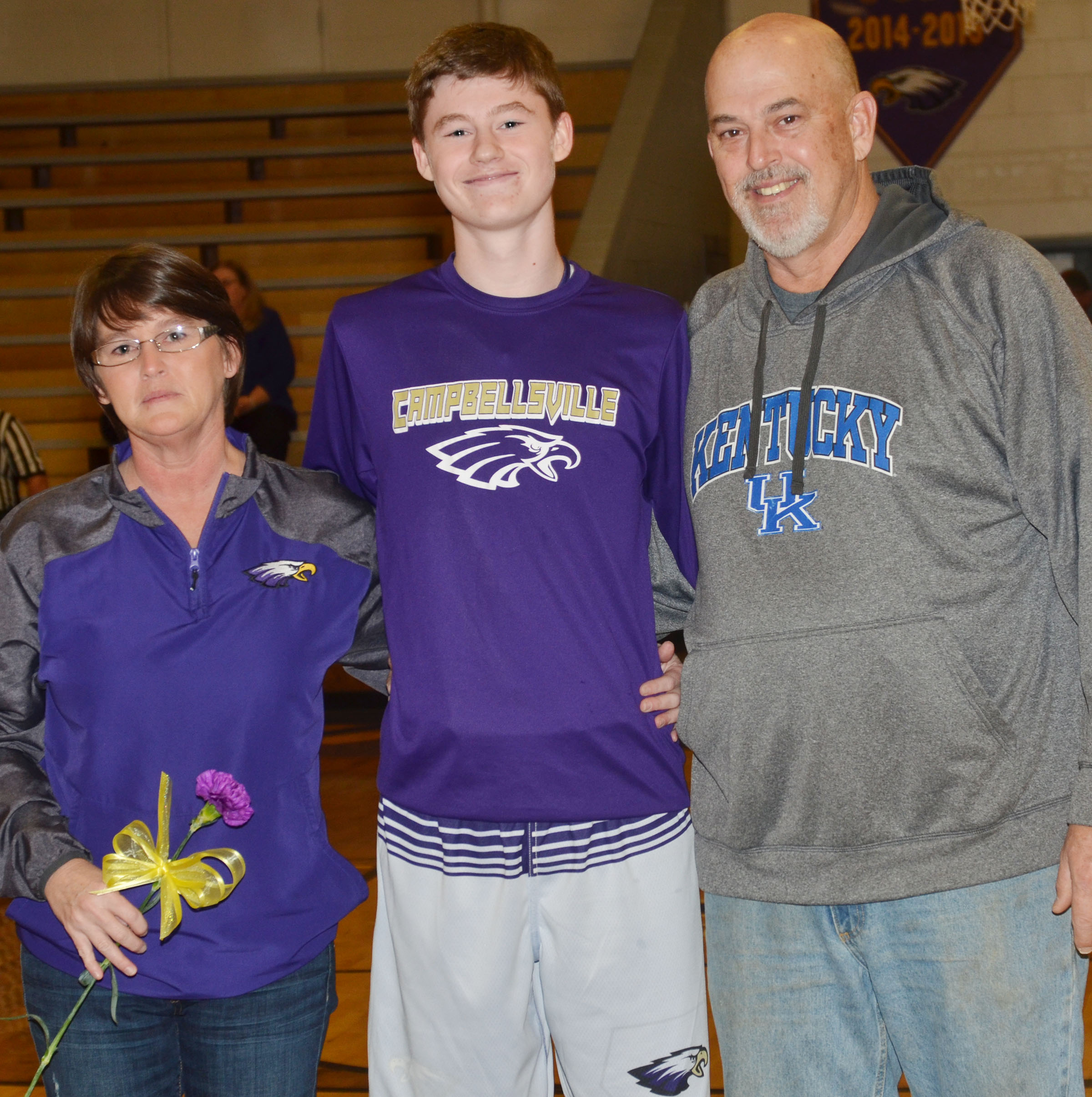 CMS eighth-grader Tristin Faulkner is honored. He is pictured with his parents, Bobbi and Dean.
