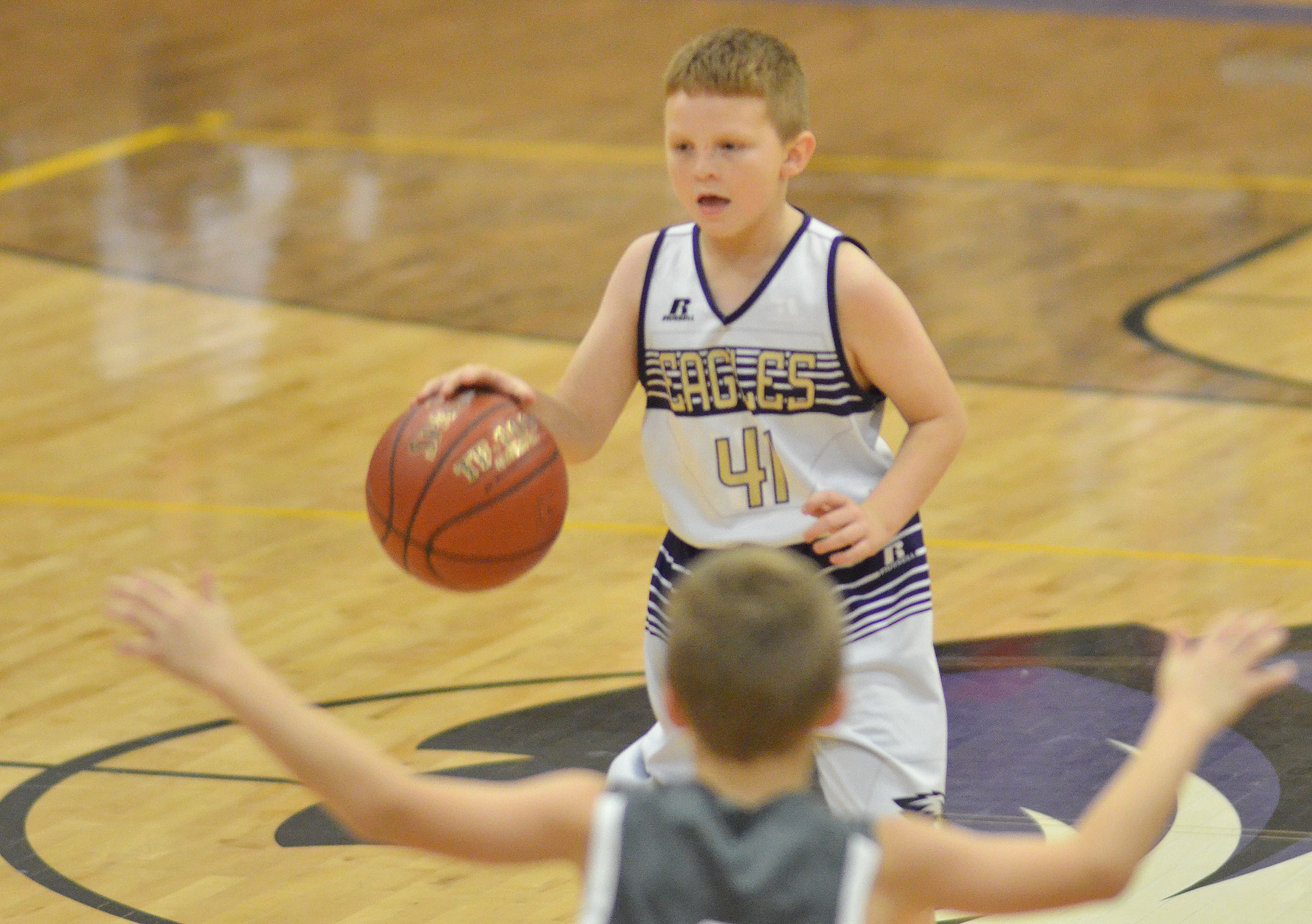 CMS fifth-grader Jason Jeffries dribbles.