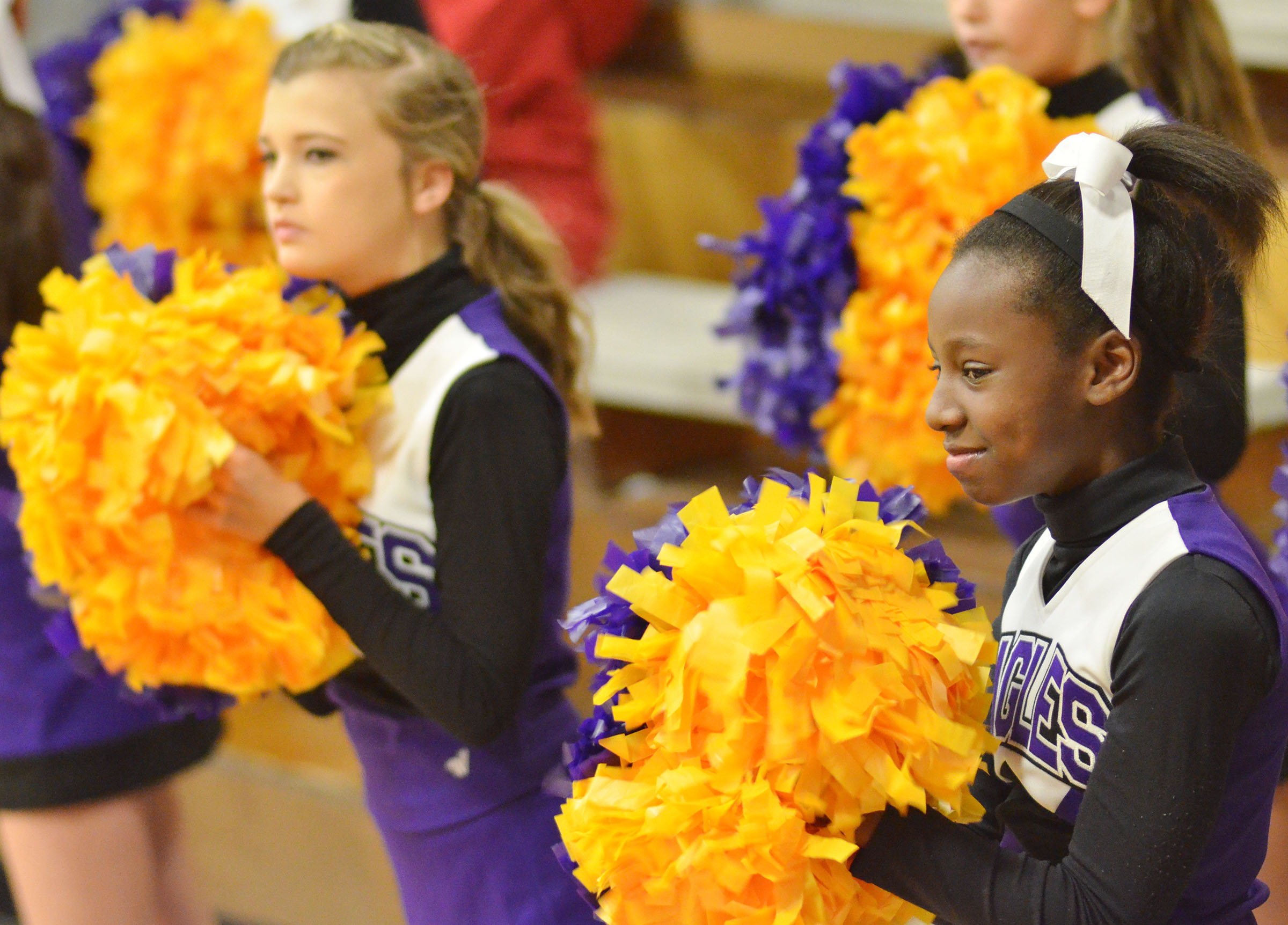 CMS seventh-grader Myricle Gholston cheers for her team.