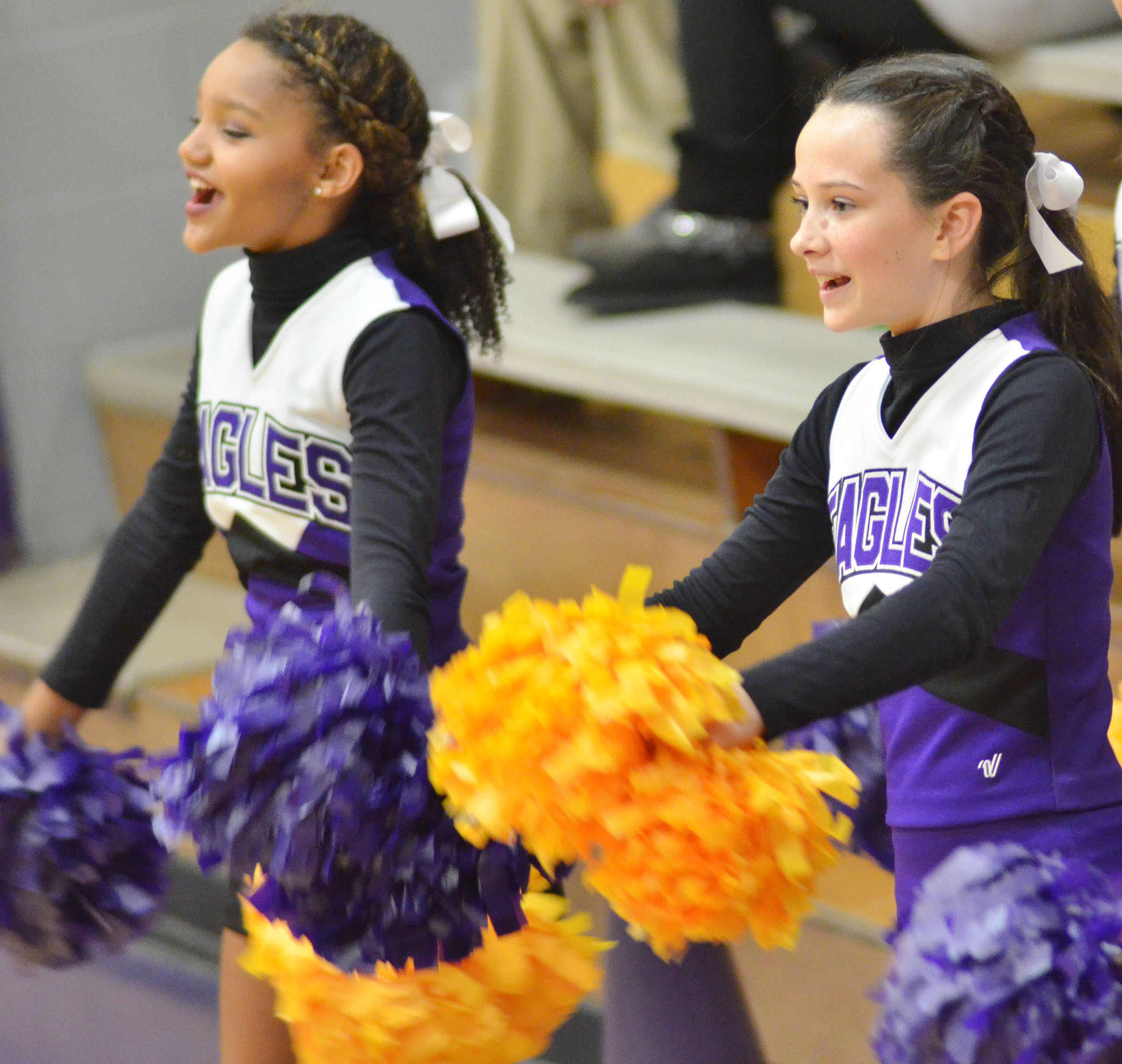 CMS seventh-graders Alexis Thomas, at left, and Sarah Adkins cheer for the Eagles.