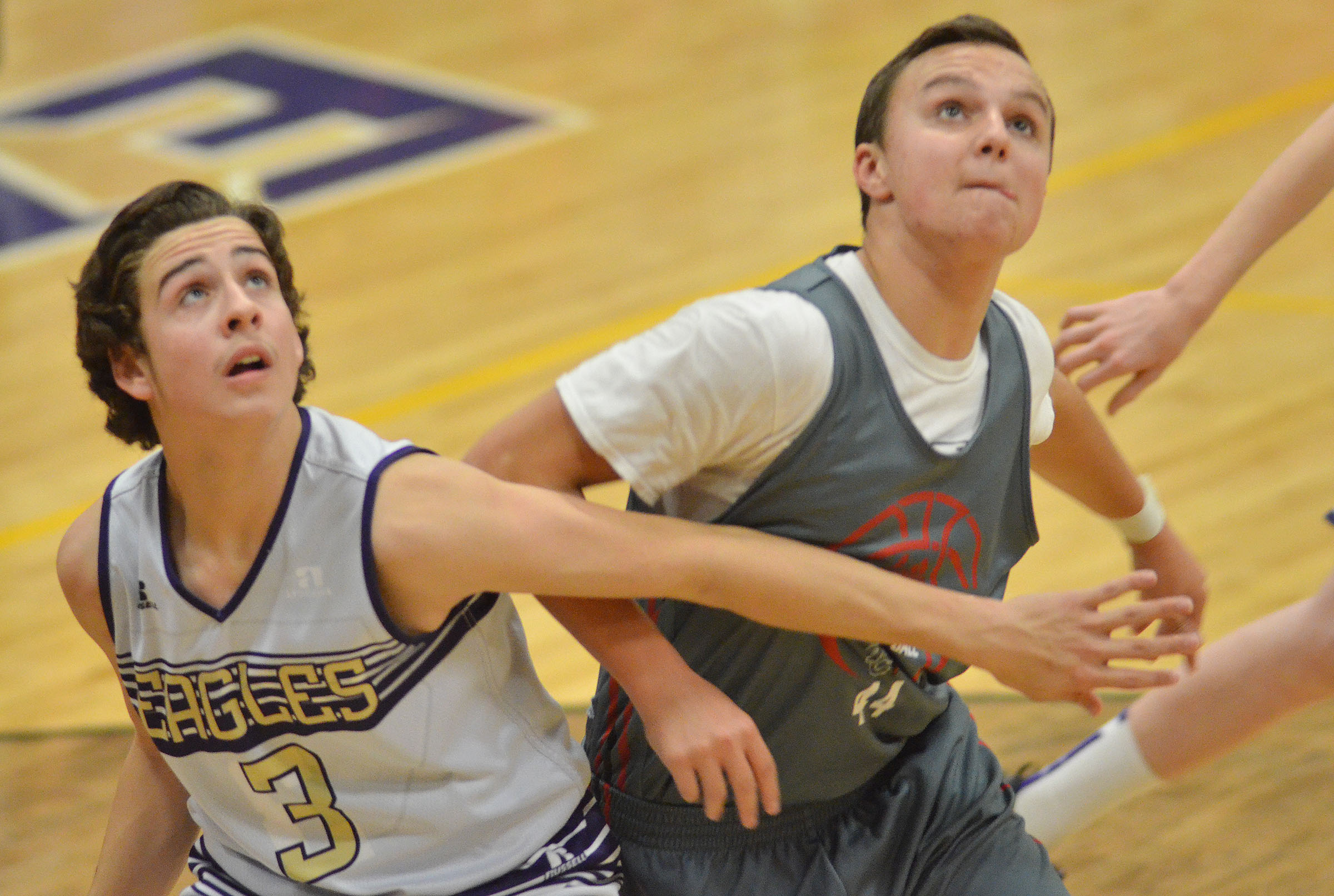 CMS eighth-grader John Orberson looks for a rebound.