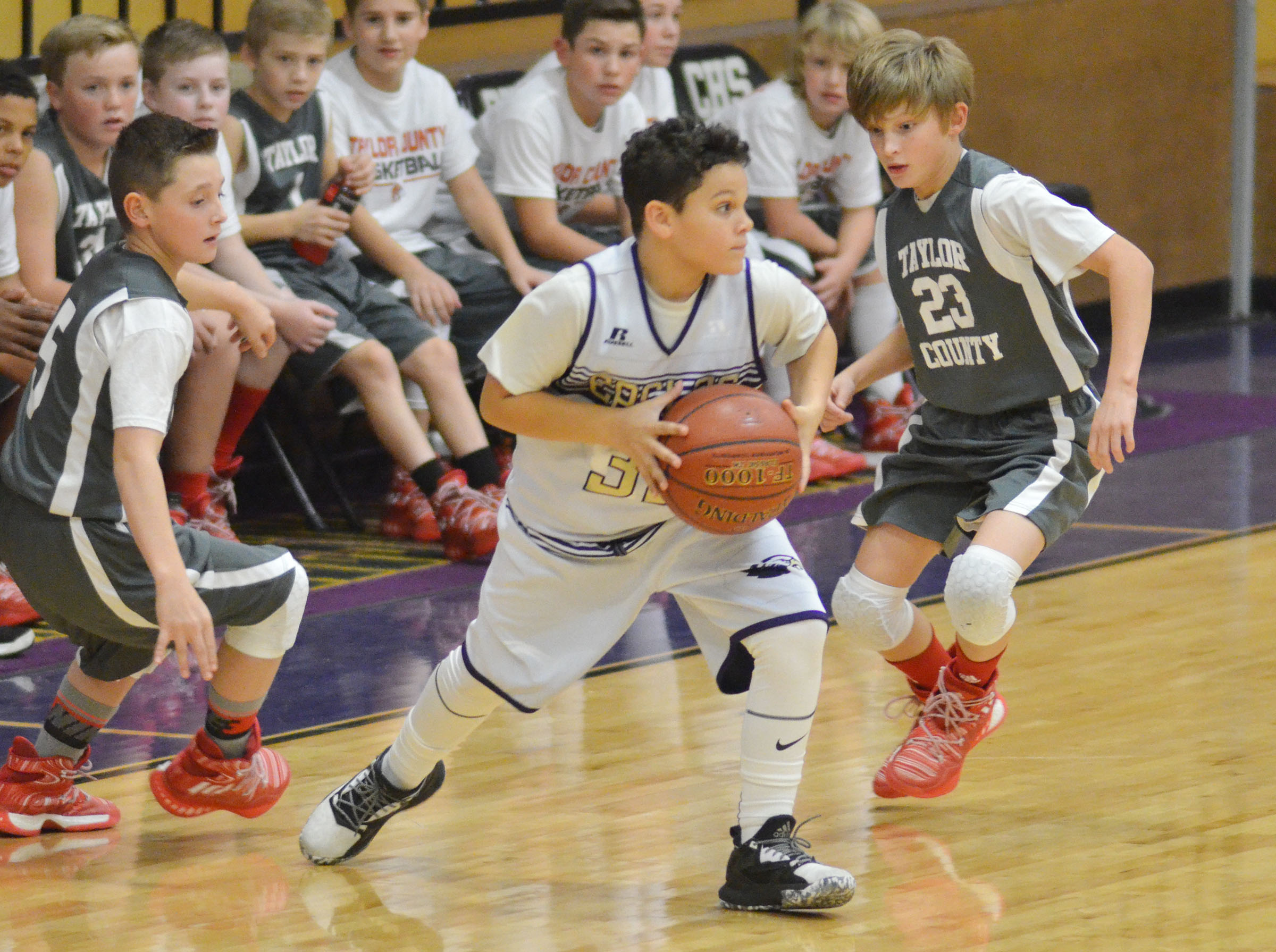 CMS sixth-grader Kaydon Taylor passes the ball.