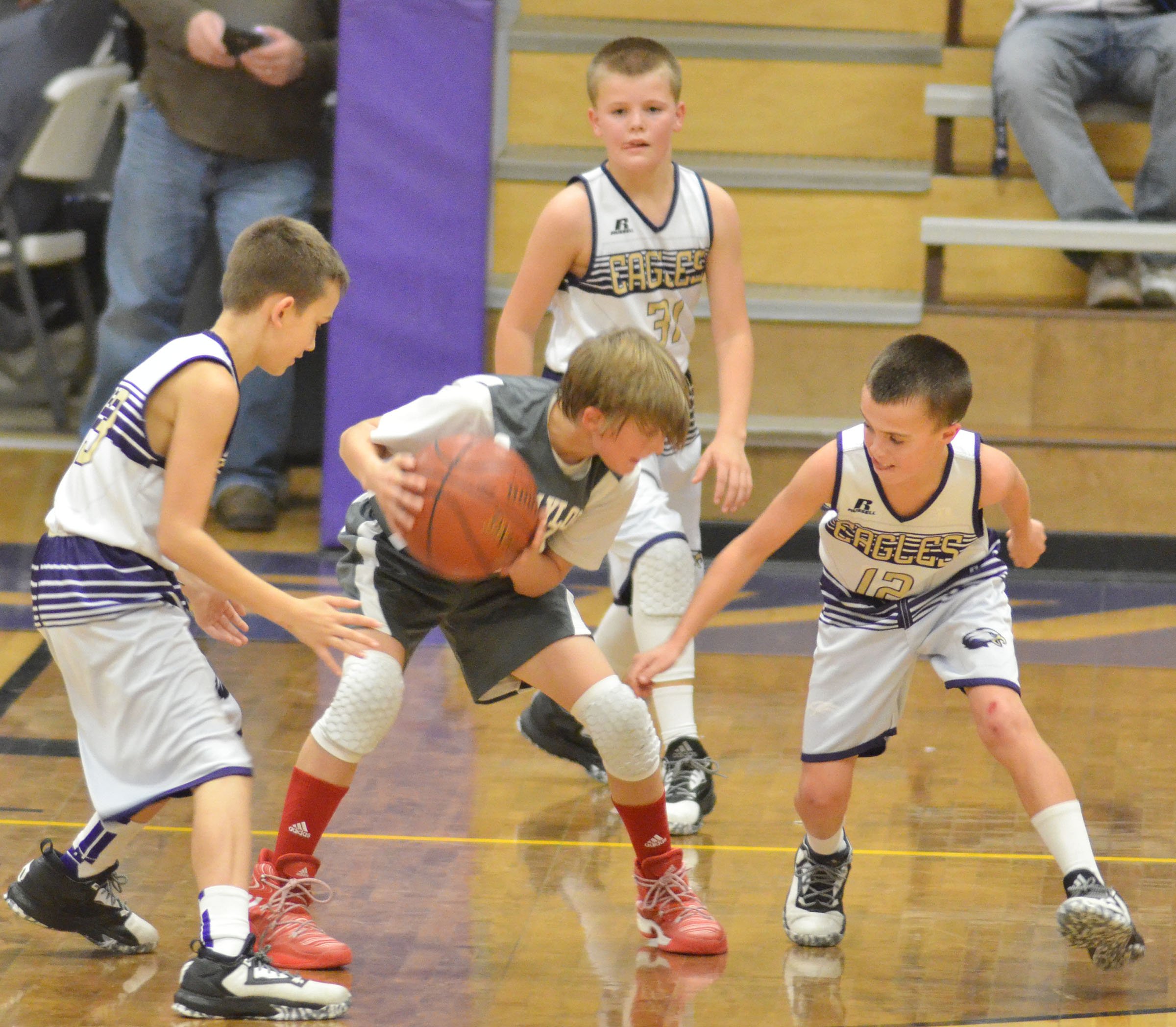 CMS sixth-graders, from left, Camren Vicari, Konner Forbis and Chase Hord play defense.