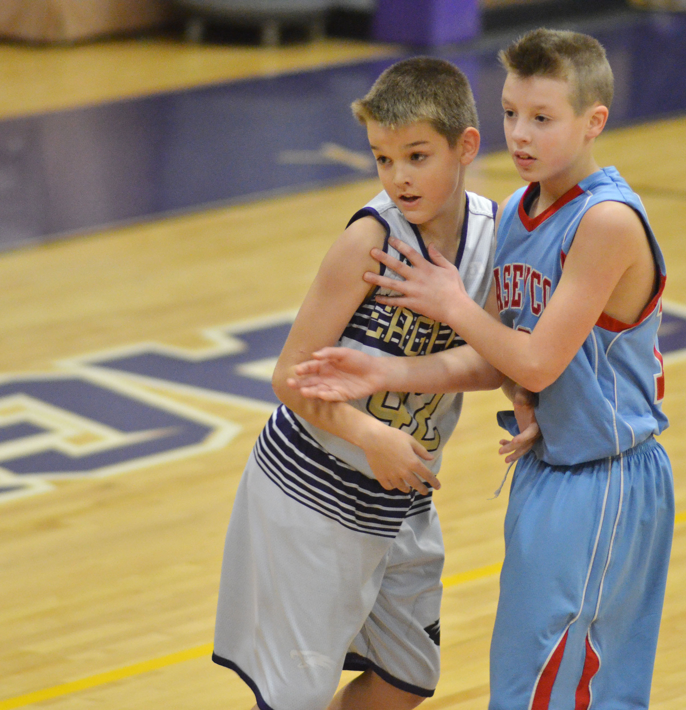 CMS fifth-grader Kaden Bloyd blocks a Casey County player.