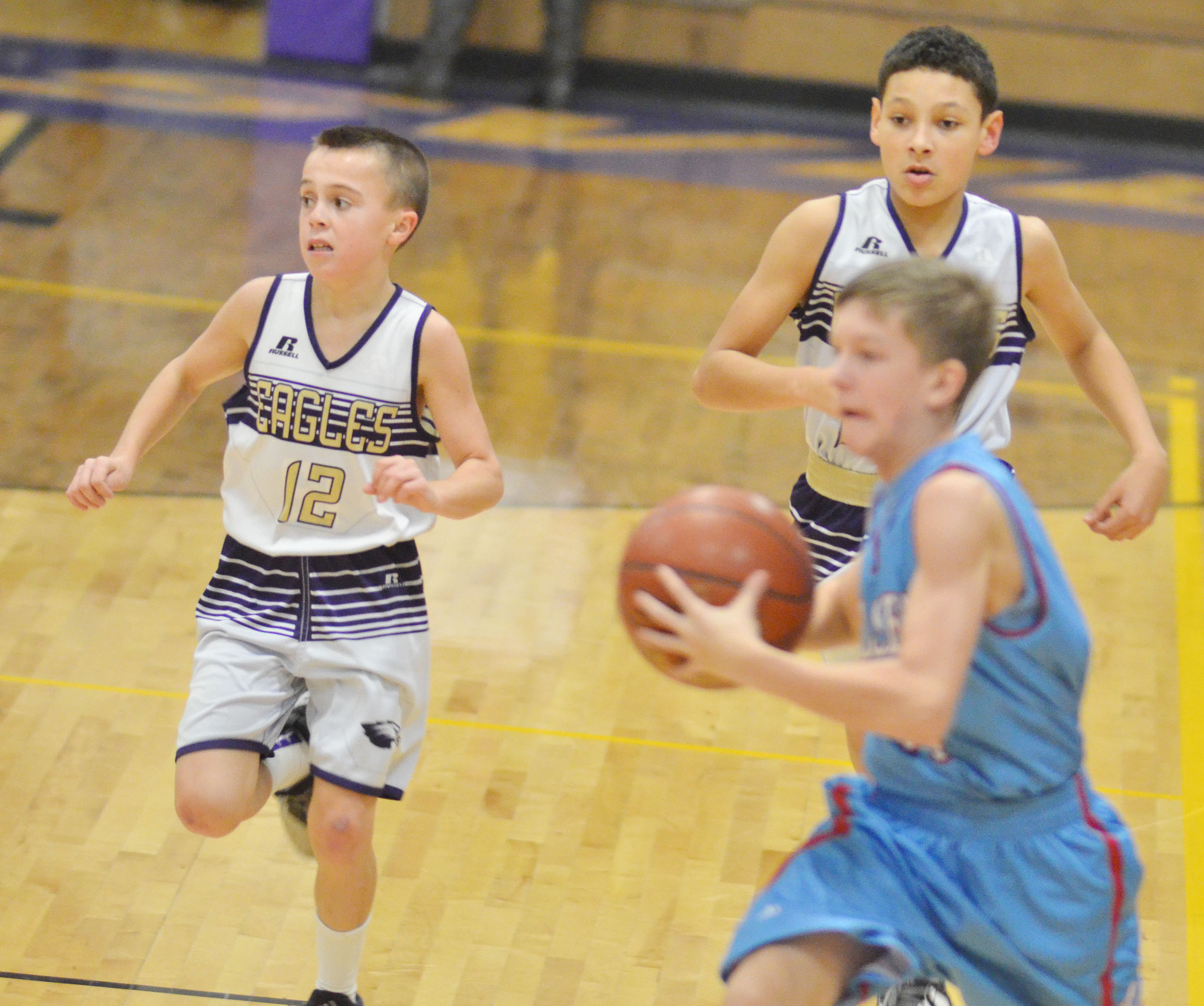 CMS sixth-graders Chase Hord, at left, and seventh-grader Brice Spaw run down the court.