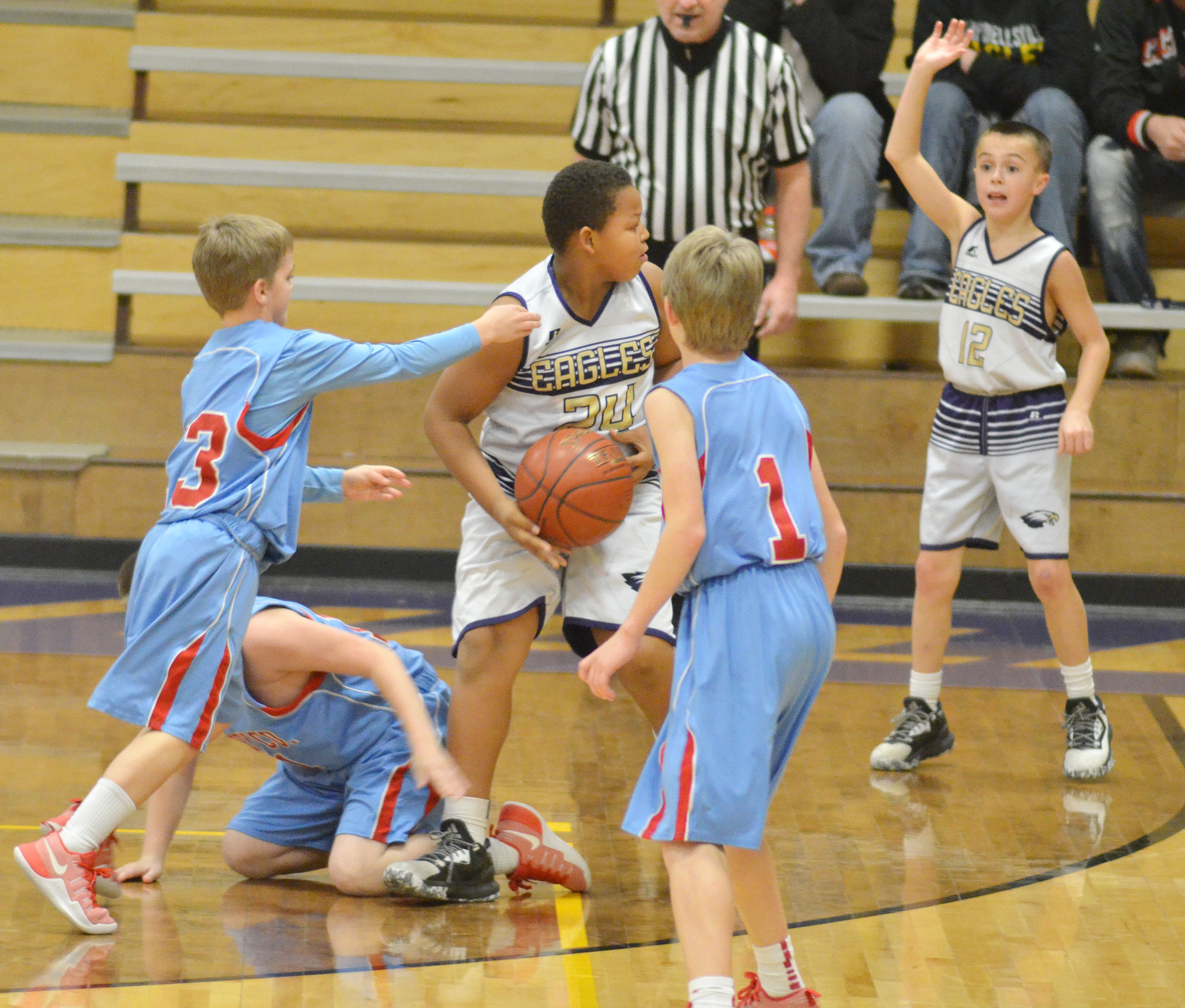 CMS sixth-grader Chase Hord calls for the ball from classmate Keondre Weathers.