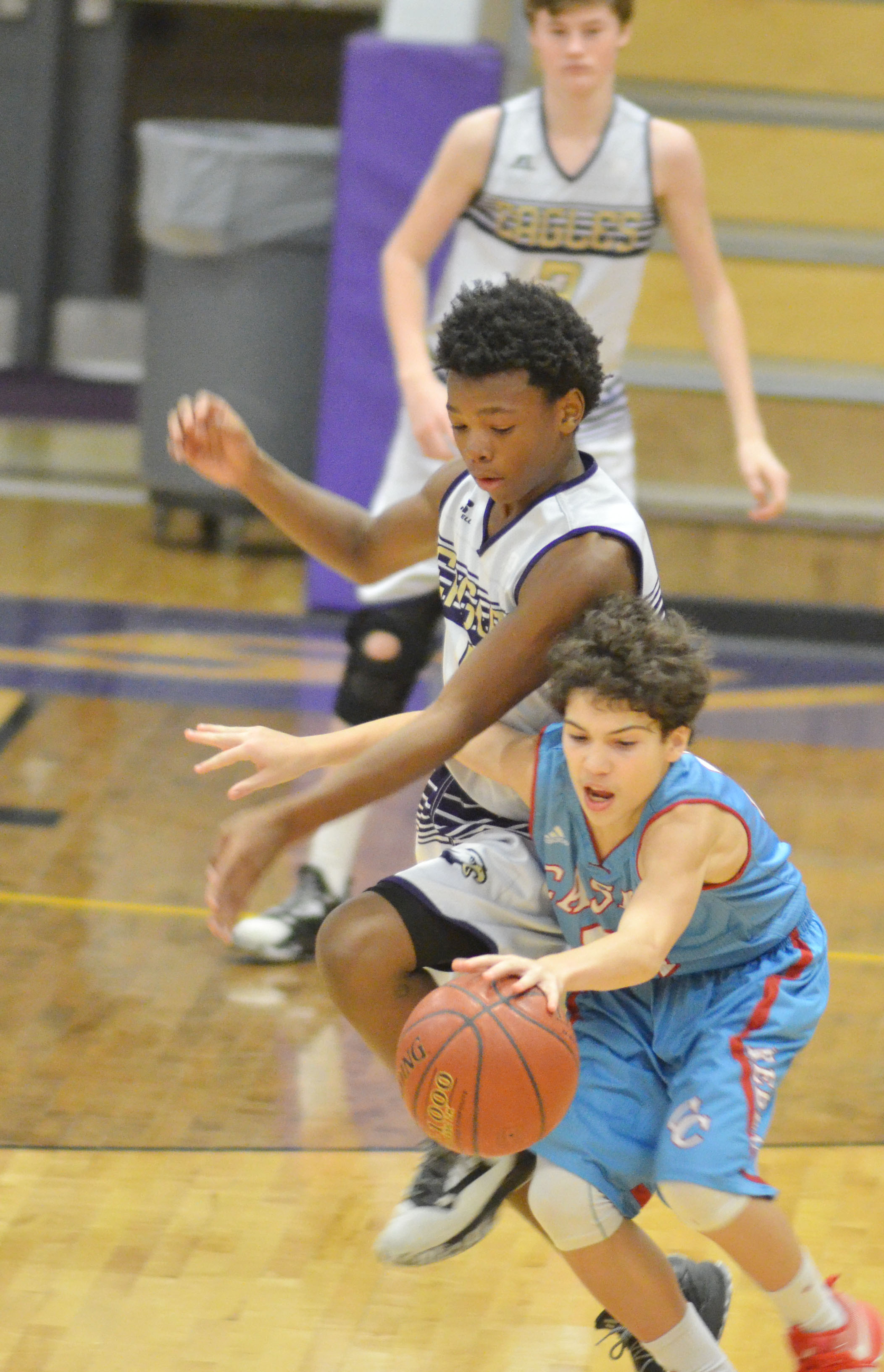 CMS eighth-grader Saevon Buckner battles for the ball.