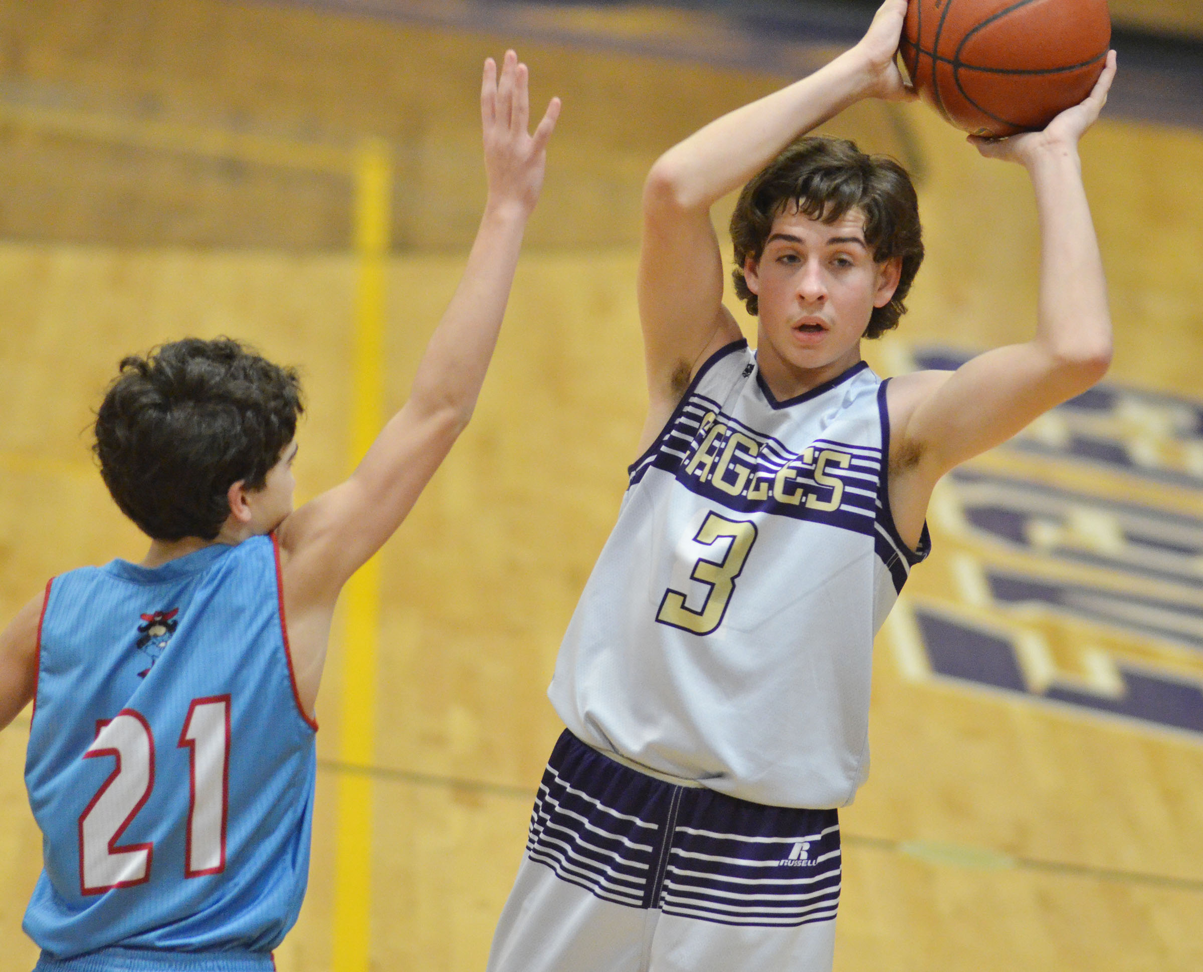 CMS eighth-grader John Orberson passes the ball.