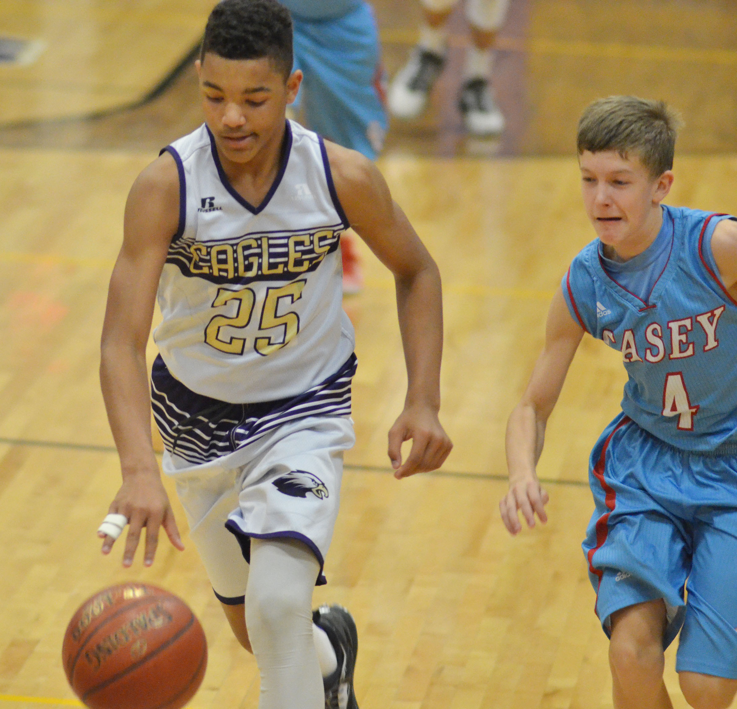 CMS eighth-grader Reggie Thomas dribbles to the basket.